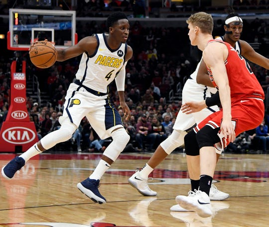 Pacers guard Victor Oladipo (4) handles the ball while defended by Chicago Bulls forward Lauri Markkanen (24) during the first half at United Center.