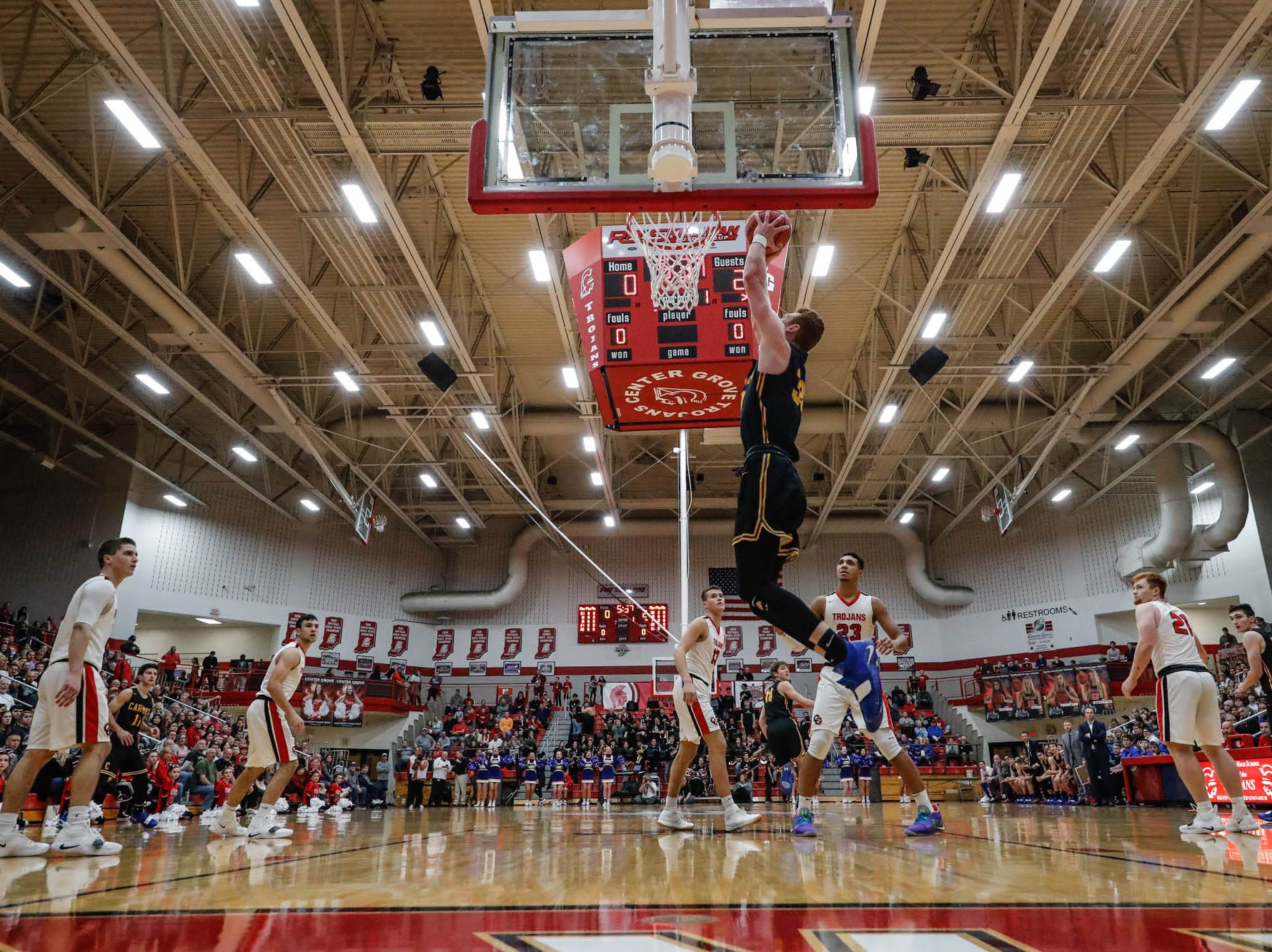 Carmel High School's John Michael Mulloy (33), dunks the ball during a game between Center Grove High School and Carmel High School, held at Center Grove on on Friday, Jan. 4, 2019.
