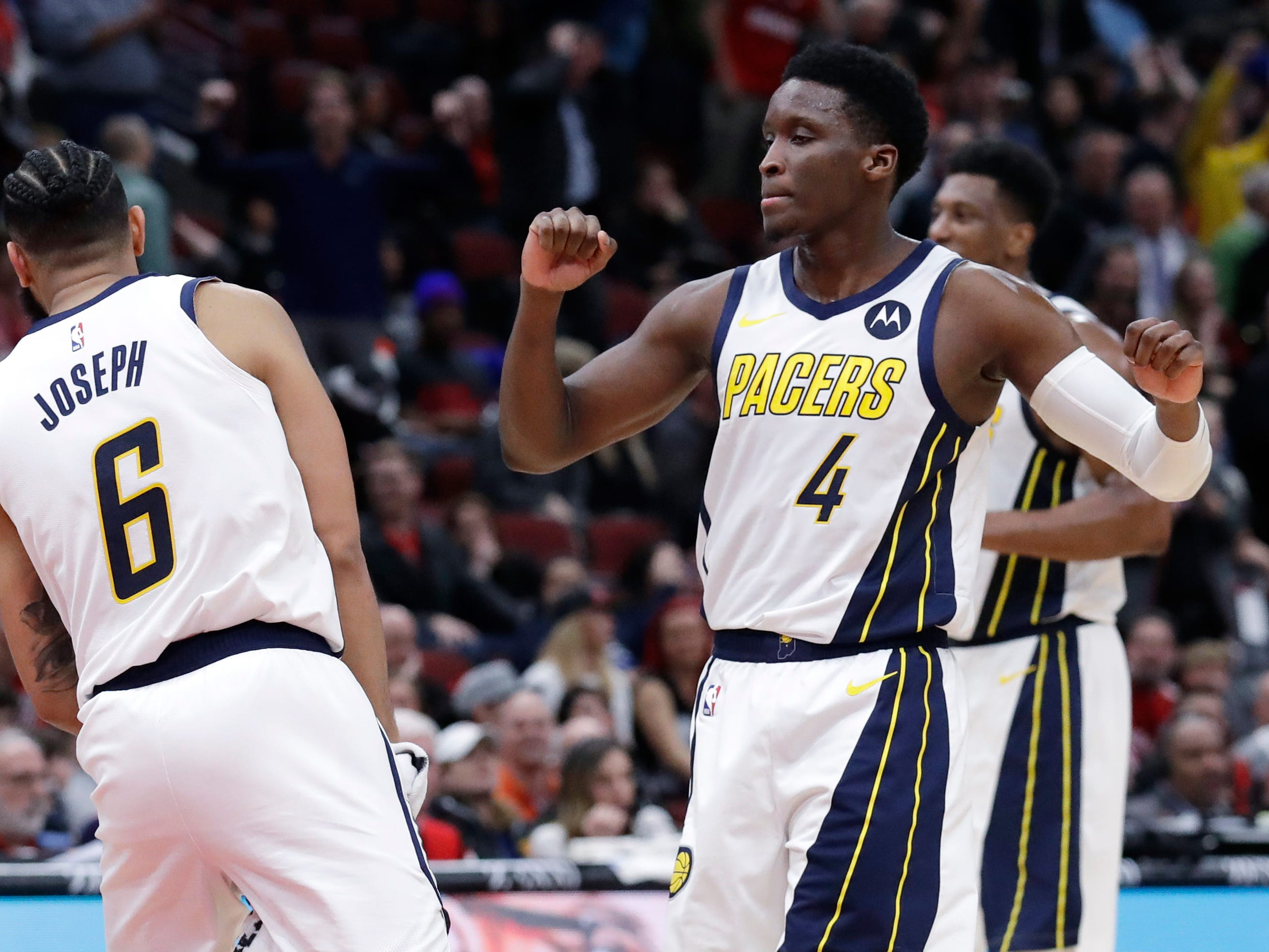 Indiana Pacers guard Victor Oladipo, right, celebrates with guard Cory Joseph after making a three-point basket against the Chicago Bulls during overtime of an NBA basketball game Friday, Jan. 4, 2019, in Chicago. (AP Photo/Nam Y. Huh)