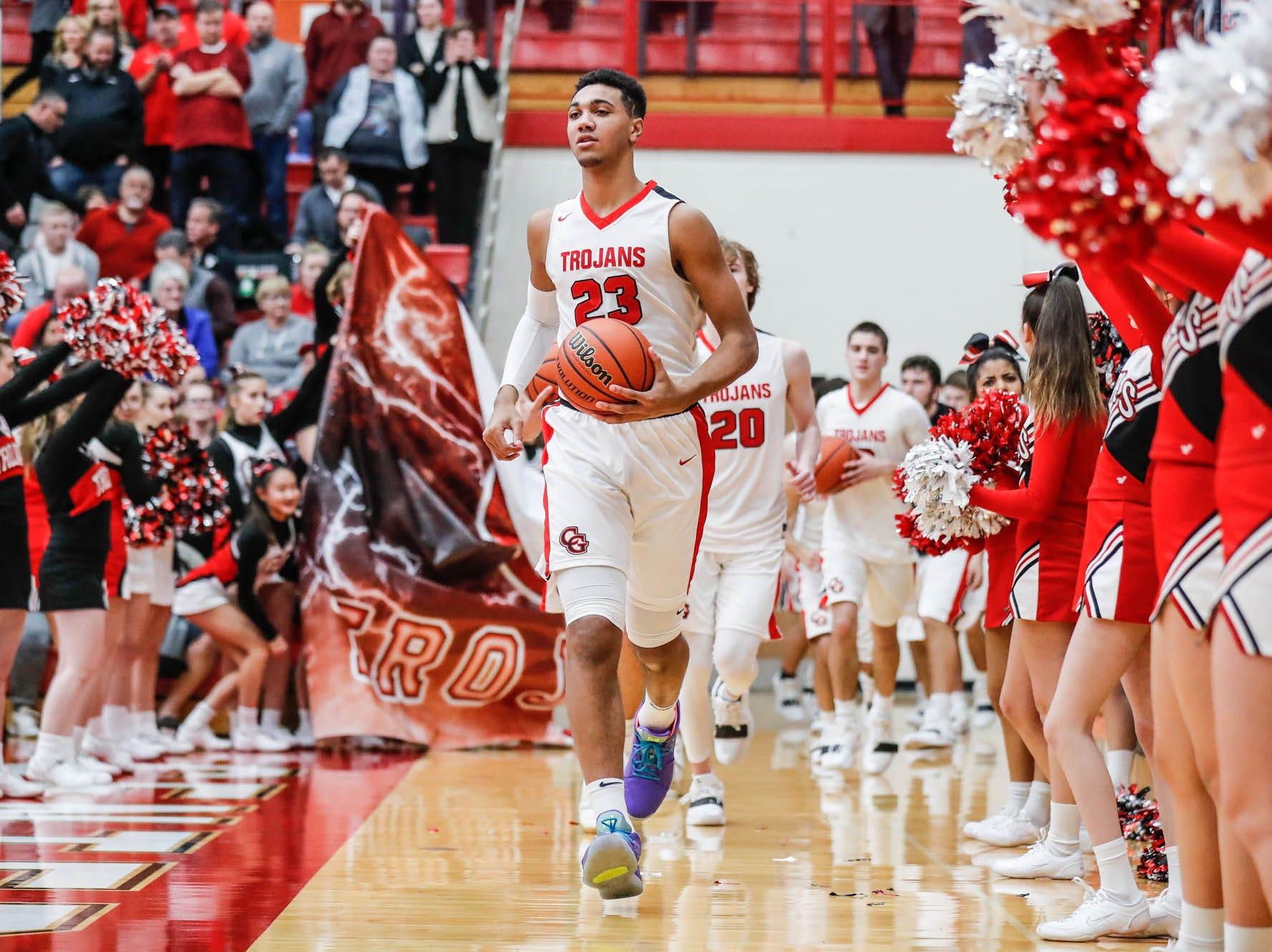 Center Grove High School's forward Trayce Jackson-Davis (23) leads the team on top the court during a game between Center Grove High School and Carmel High School, held at Center Grove on on Friday, Jan. 4, 2019.