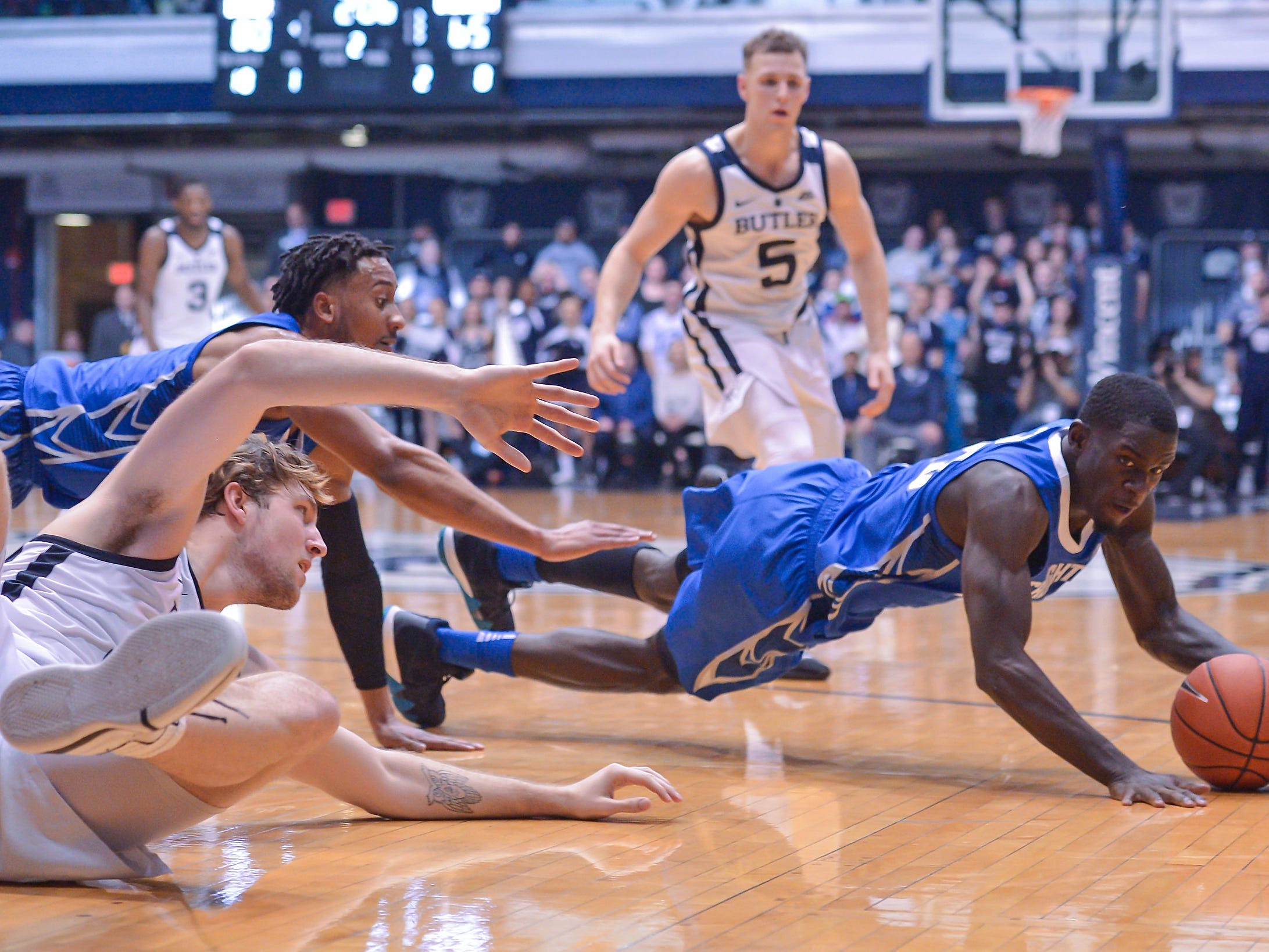 Creighton Bluejays forward Damien Jefferson (23) dives for a steal against the Butler Bulldogs during the second half of game action between Butler University and Creighton University, at Hinkle Fieldhouse in Indianapolis, Indiana on Saturday, Jan. 5, 2019. The Butler Bulldogs defeated the Creighton Bluejays 84-69.