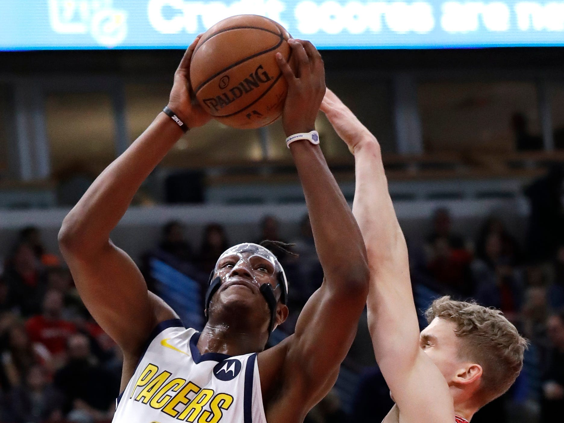 Indiana Pacers center Myles Turner, left, shoots against Chicago Bulls forward Lauri Markkanen during the first half of an NBA basketball game Friday, Jan. 4, 2019, in Chicago. (AP Photo/Nam Y. Huh)