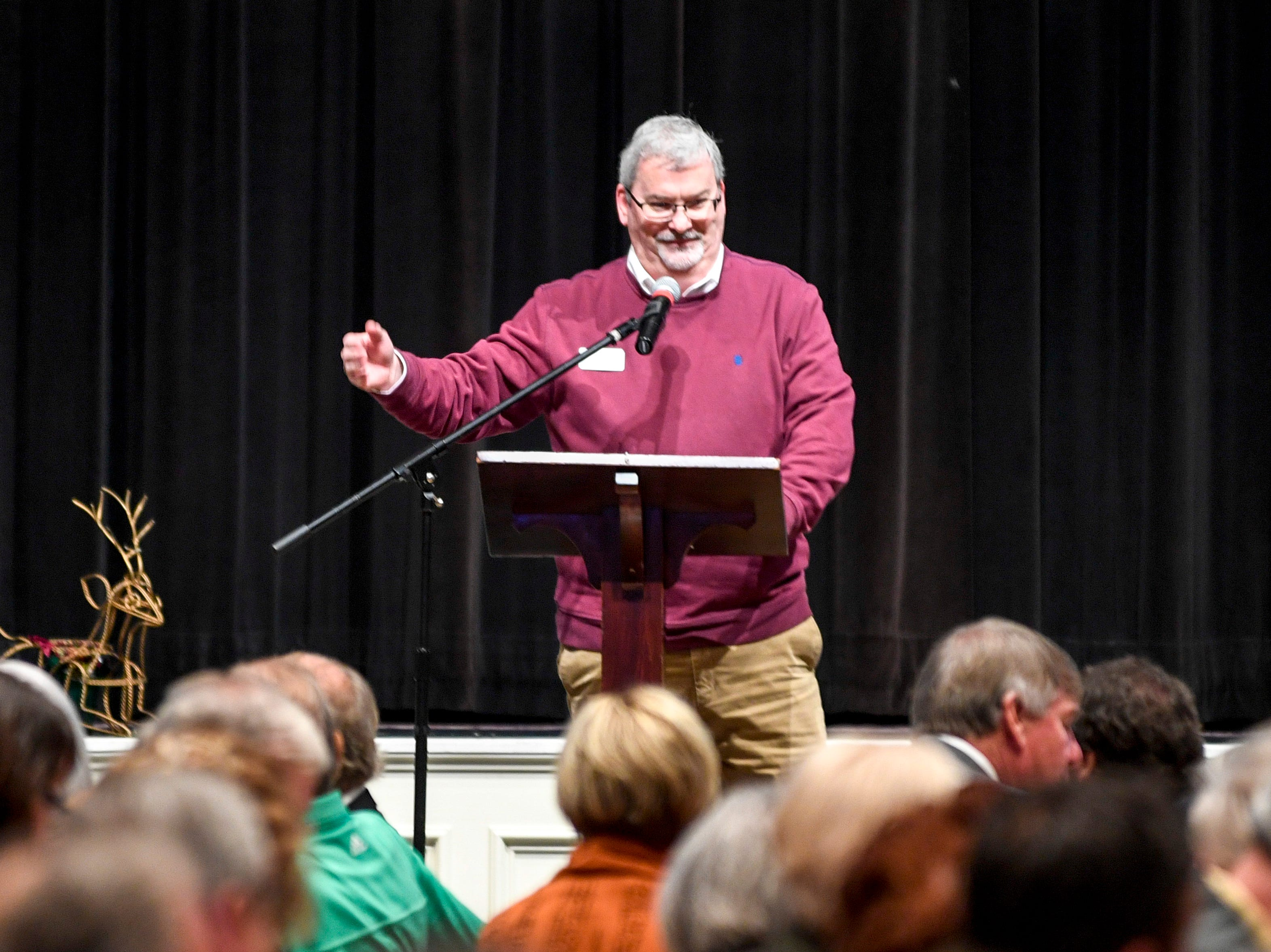 Senior Pastor of the church Sky McCracken speaks at the podium to welcome guests during the monthly First Friday Forum at First United Methodist Church in Jackson, Tenn., on Friday, Jan. 4, 2019.