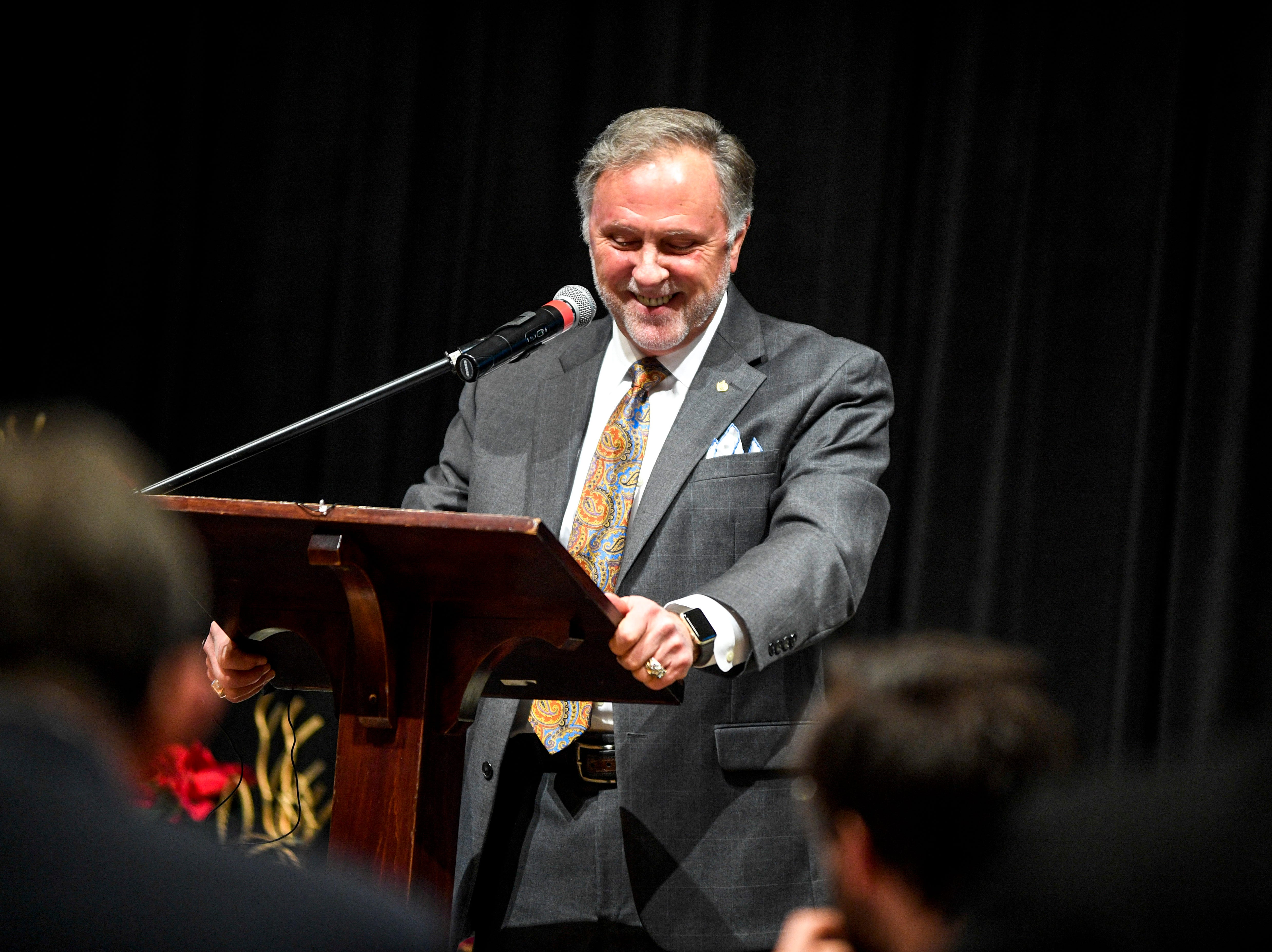 Madison County Mayor Jimmy Harris smiles while introducing himself at the podium during the monthly First Friday Forum at First United Methodist Church in Jackson, Tenn., on Friday, Jan. 4, 2019.