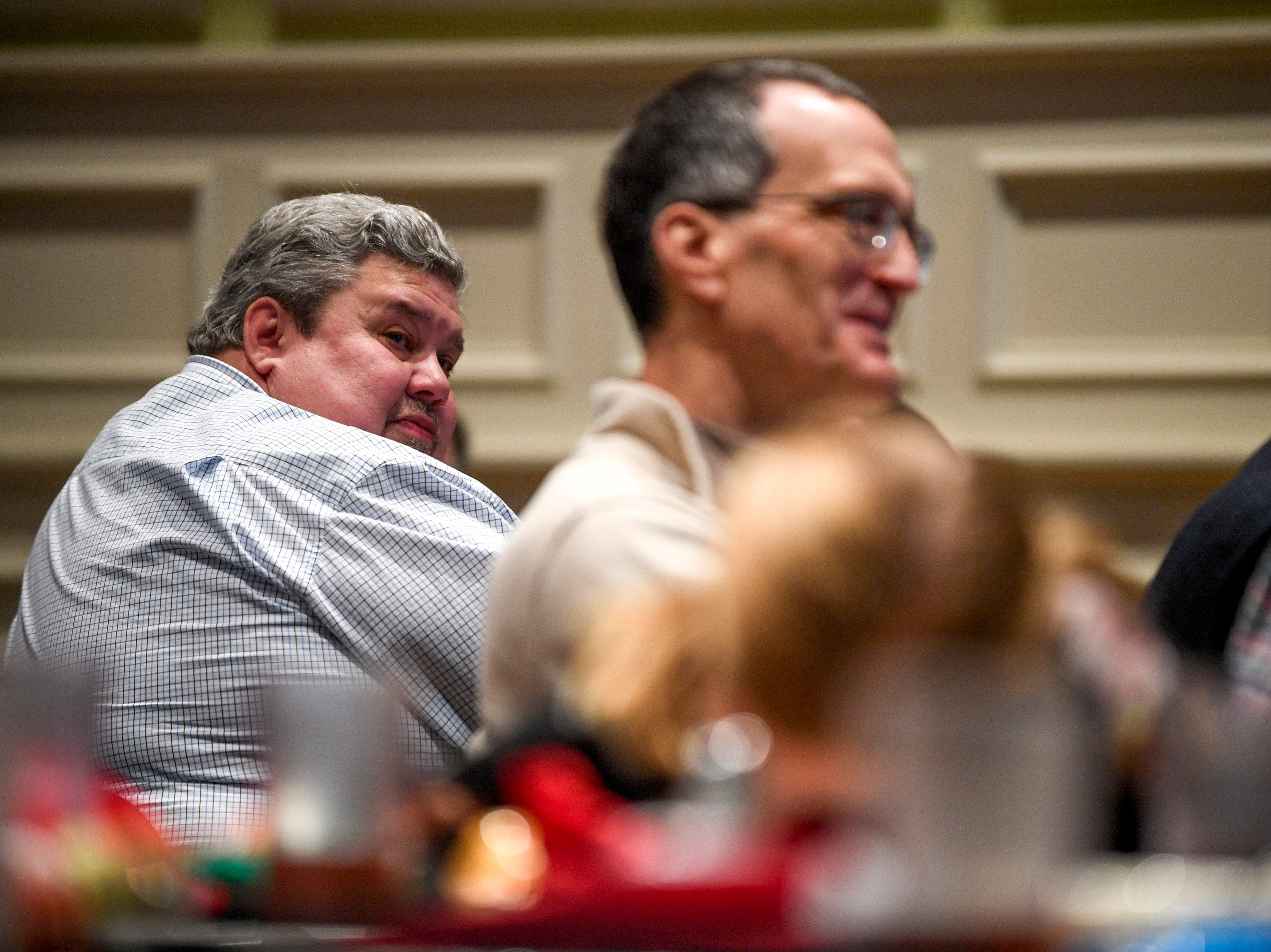 Guests listen to speakers at the podium during the monthly First Friday Forum at First United Methodist Church in Jackson, Tenn., on Friday, Jan. 4, 2019.