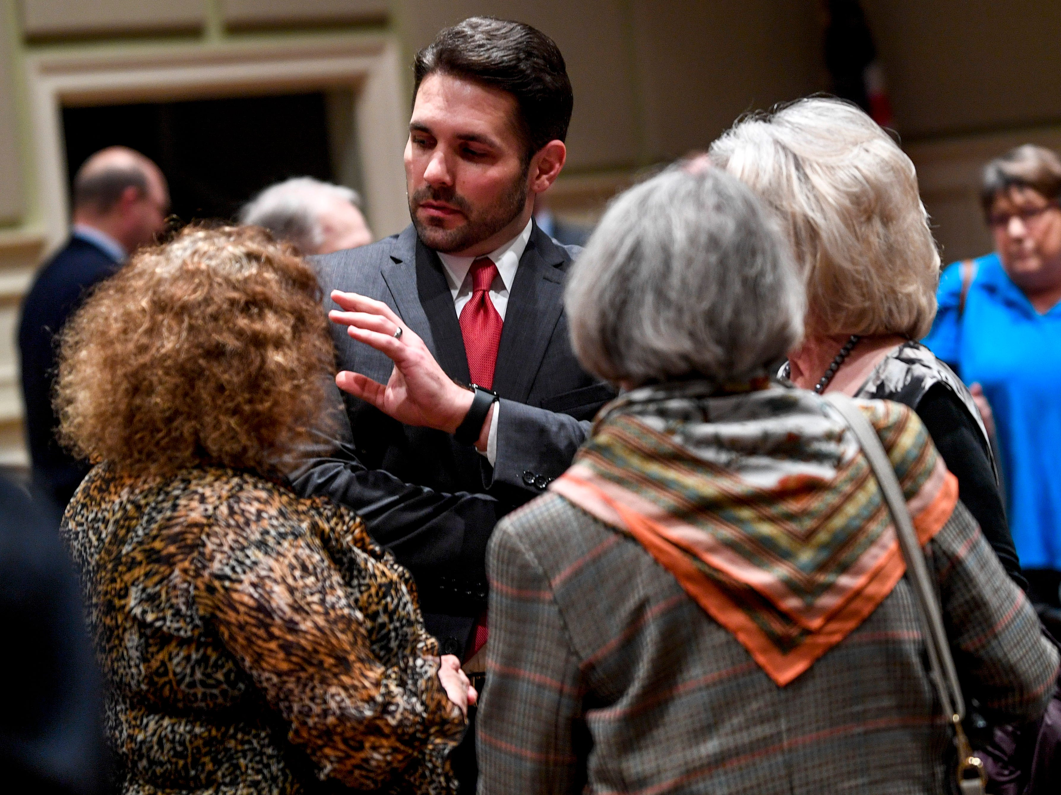 Mayoral candidate Scott Conger speaks with guests after the monthly First Friday Forum at First United Methodist Church in Jackson, Tenn., on Friday, Jan. 4, 2019.