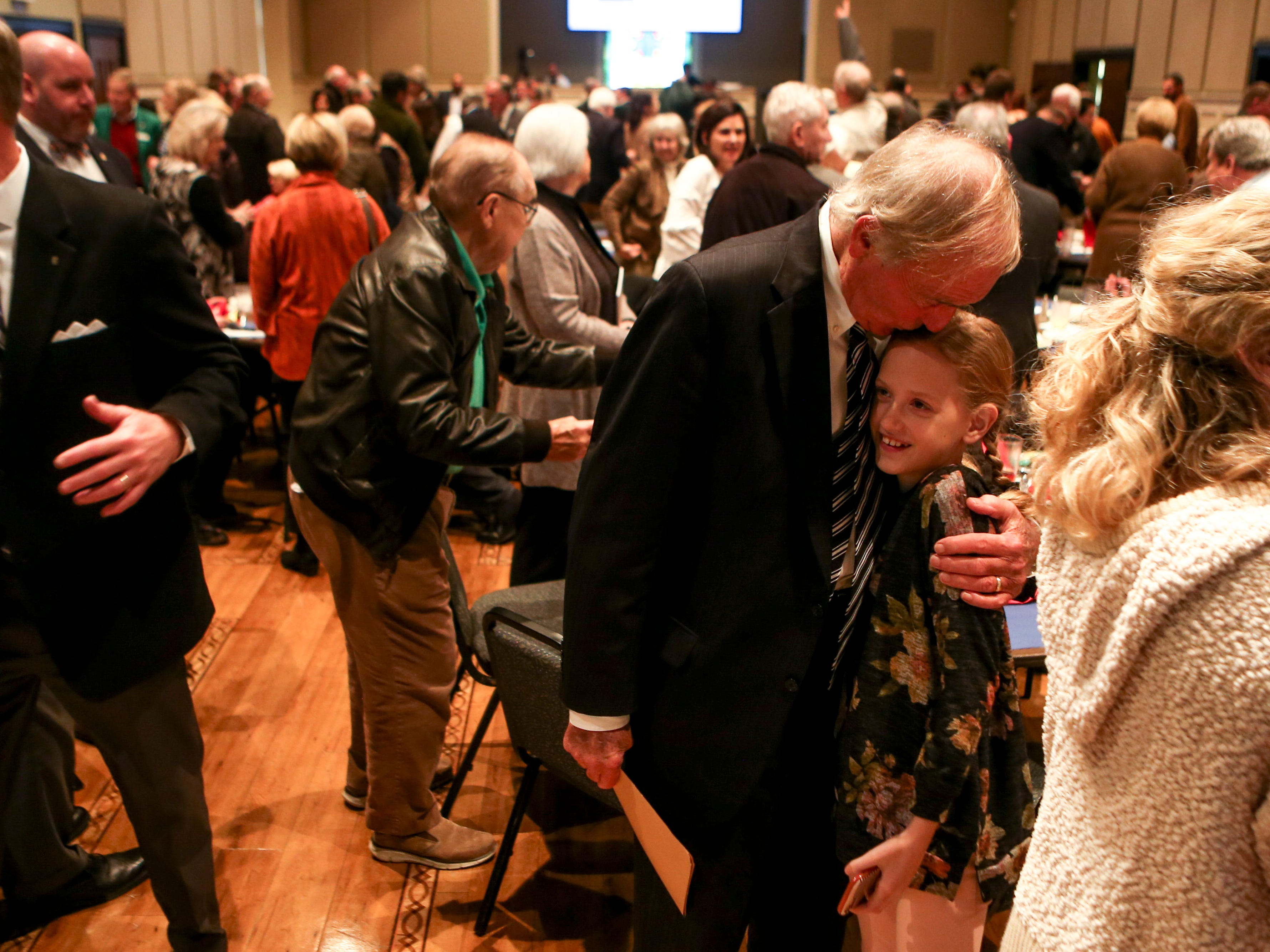 Jackson City Mayor Jerry Gist hugs and kisses his granddaughter Elizabeth Jones, 9, after the monthly First Friday Forum at First United Methodist Church in Jackson, Tenn., on Friday, Jan. 4, 2019.