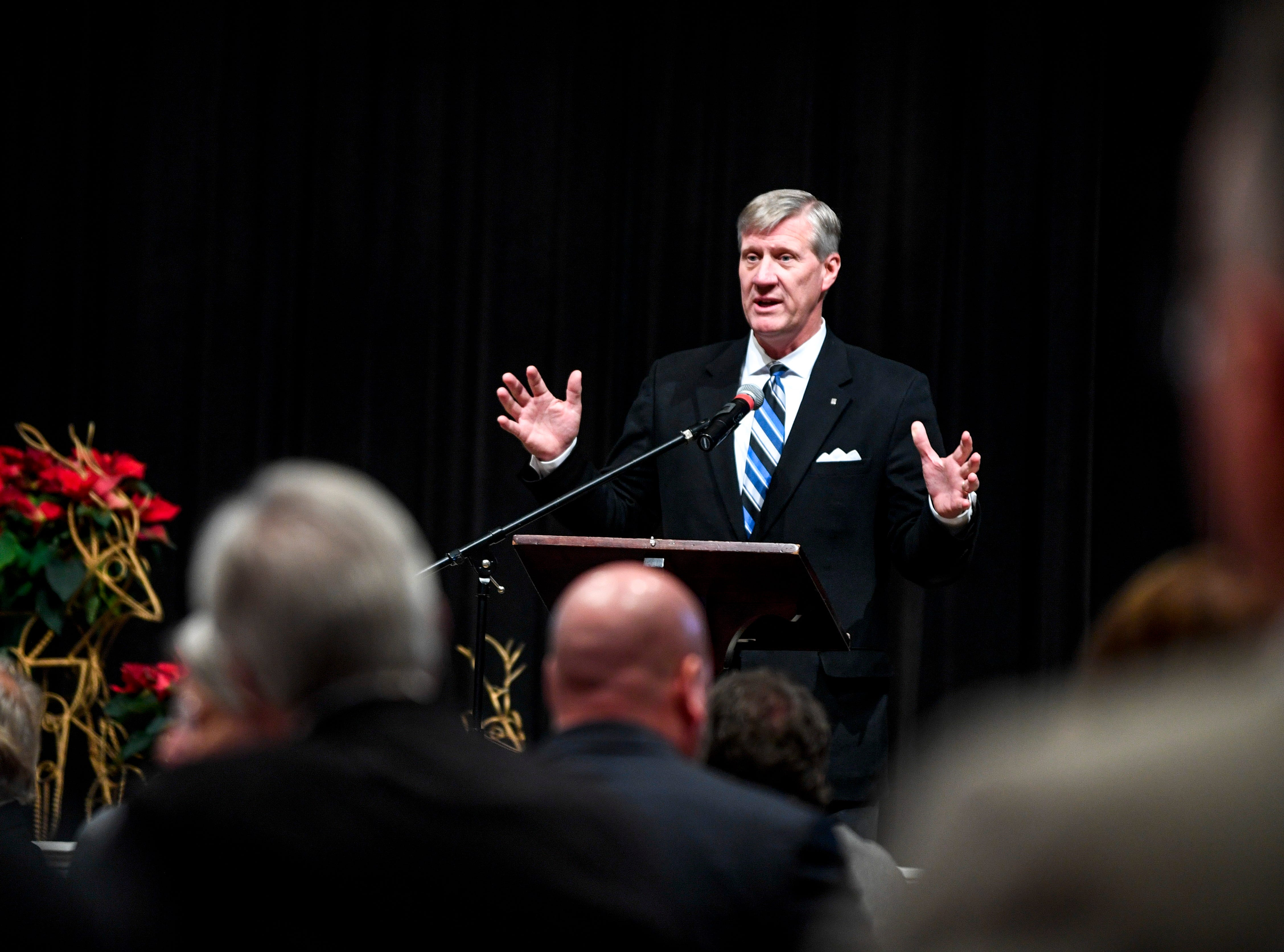 Doug Roth speaks at the podium during the monthly First Friday Forum at First United Methodist Church in Jackson, Tenn., on Friday, Jan. 4, 2019.