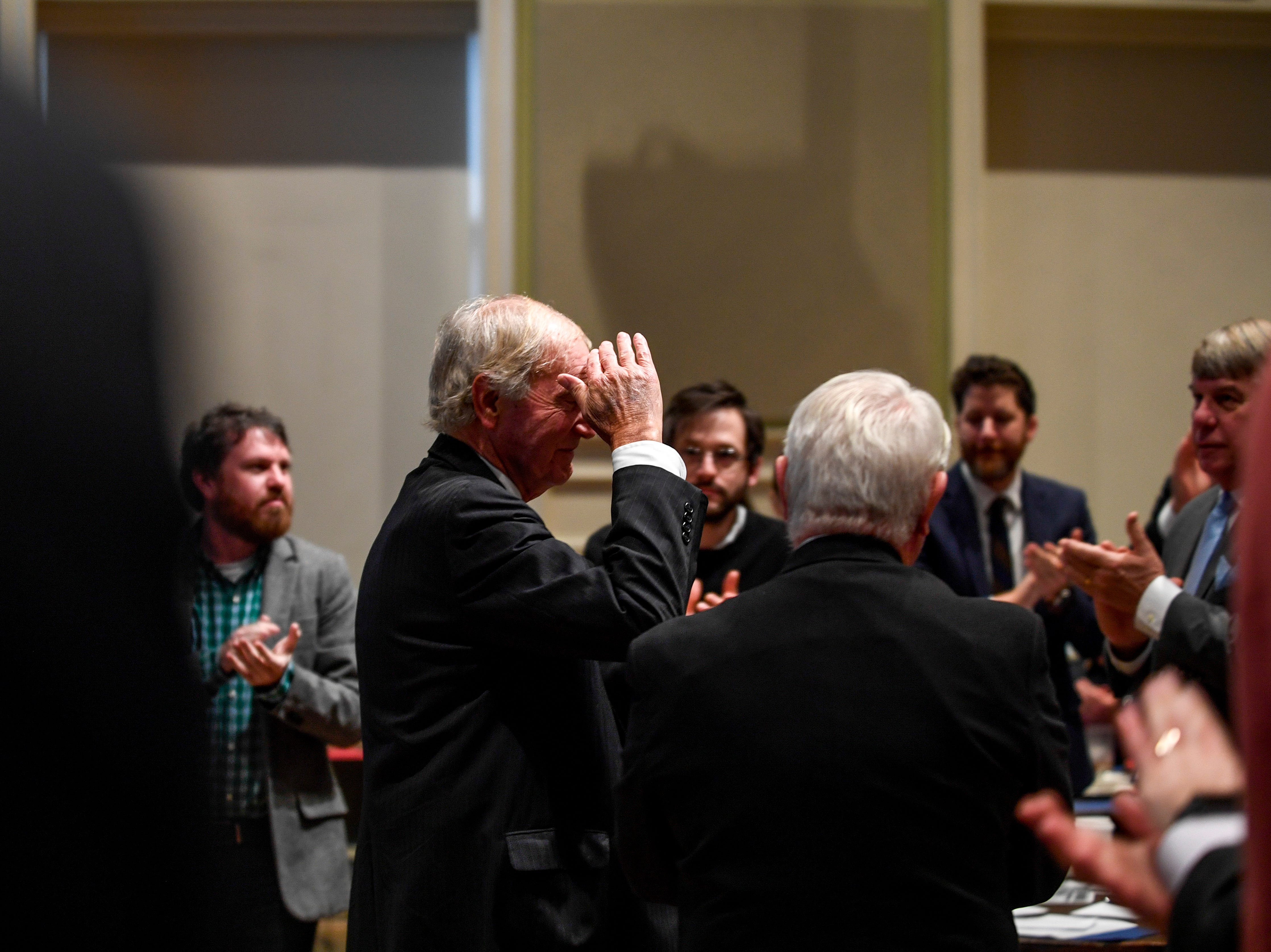 Jackson City Mayor Jerry Gist gives a salute to a crowd applauding him during the monthly First Friday Forum at First United Methodist Church in Jackson, Tenn., on Friday, Jan. 4, 2019.