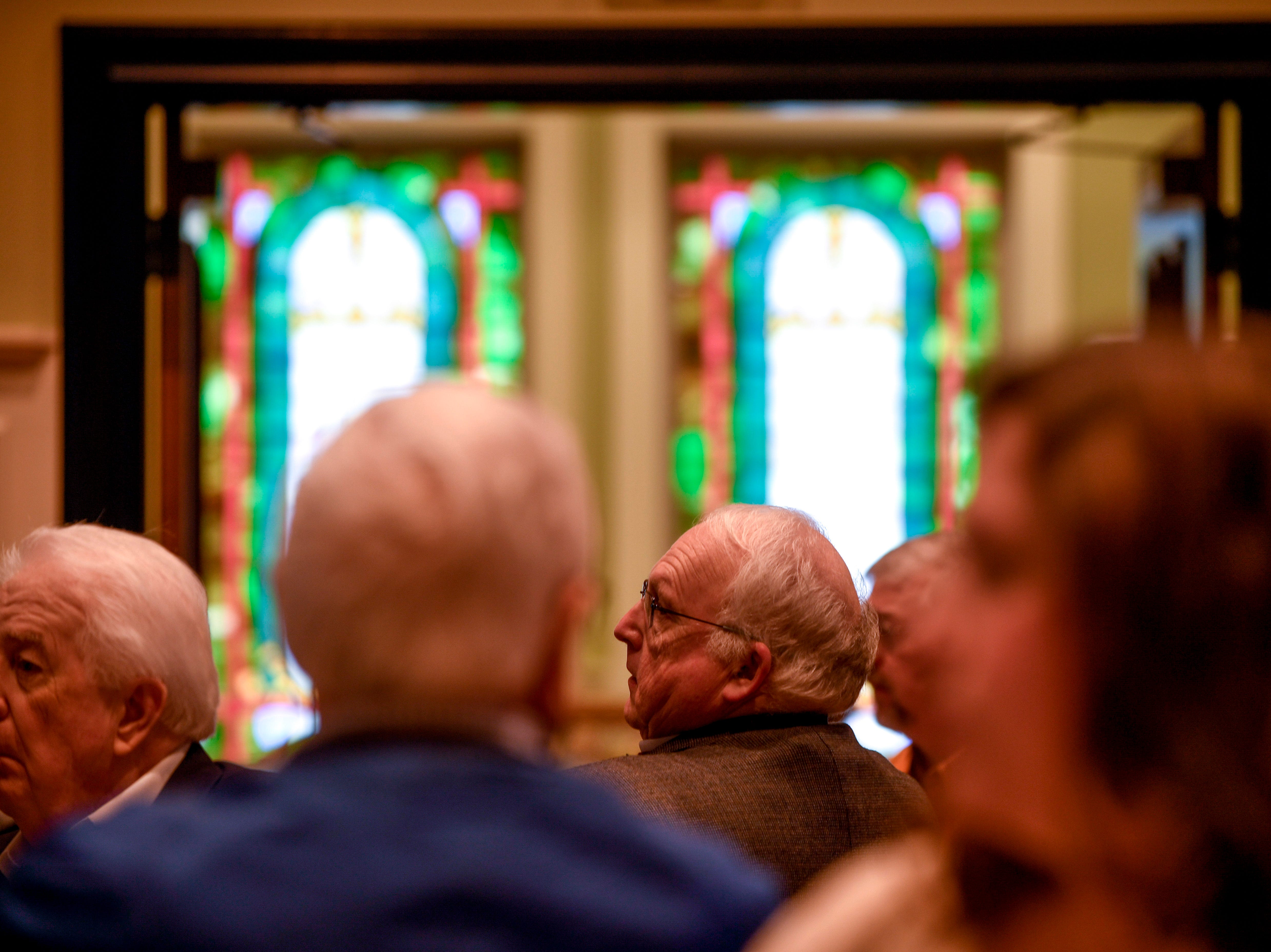 Crowd members listen to speakers during the monthly First Friday Forum at First United Methodist Church in Jackson, Tenn., on Friday, Jan. 4, 2019.
