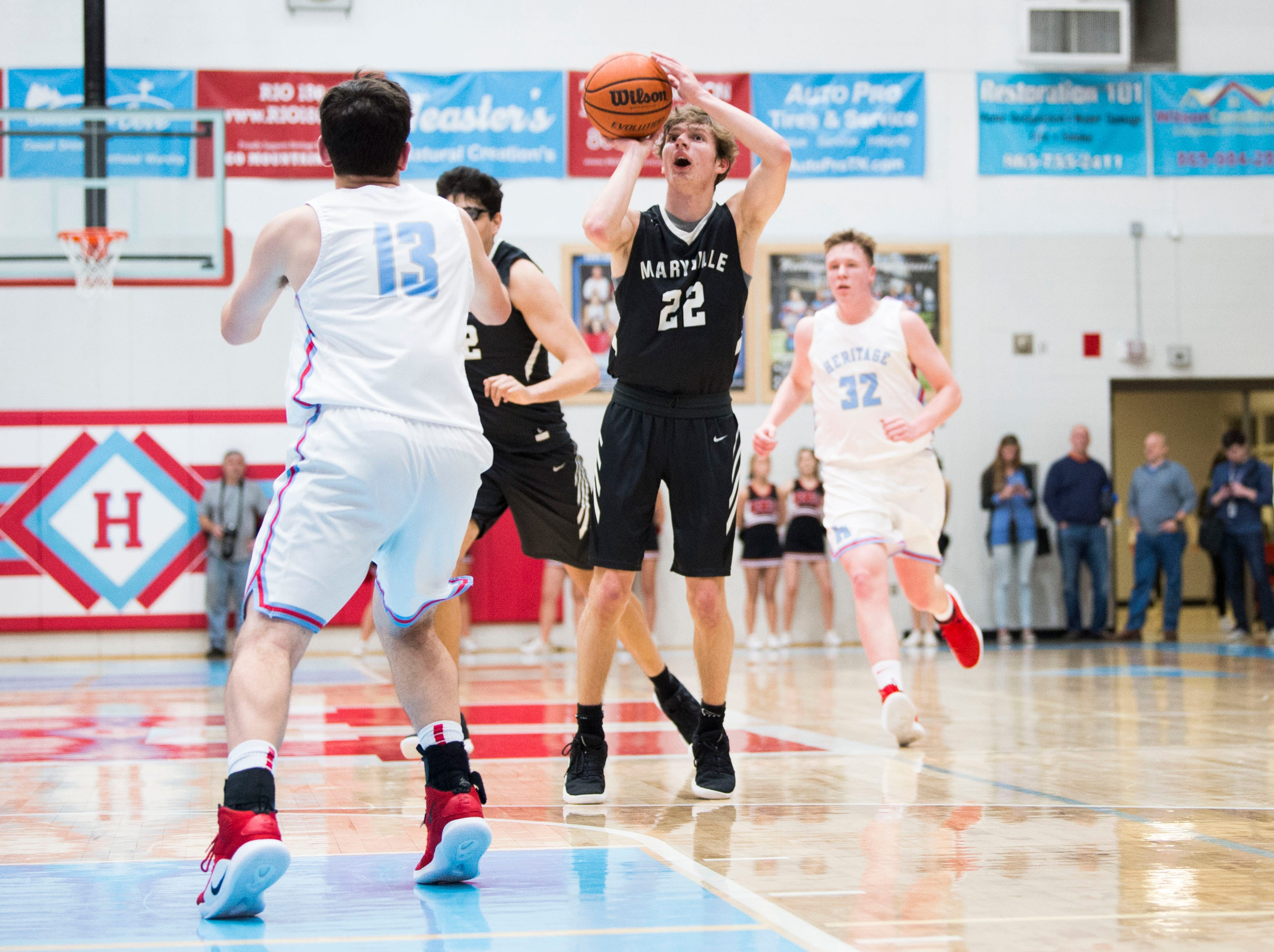 Maryville's Joe Anderson (22) takes a shot during a high school basketball game between Maryville and Heritage at Heritage Friday, Jan. 4, 2019. Both Maryville boys and girls teams beat Heritage.