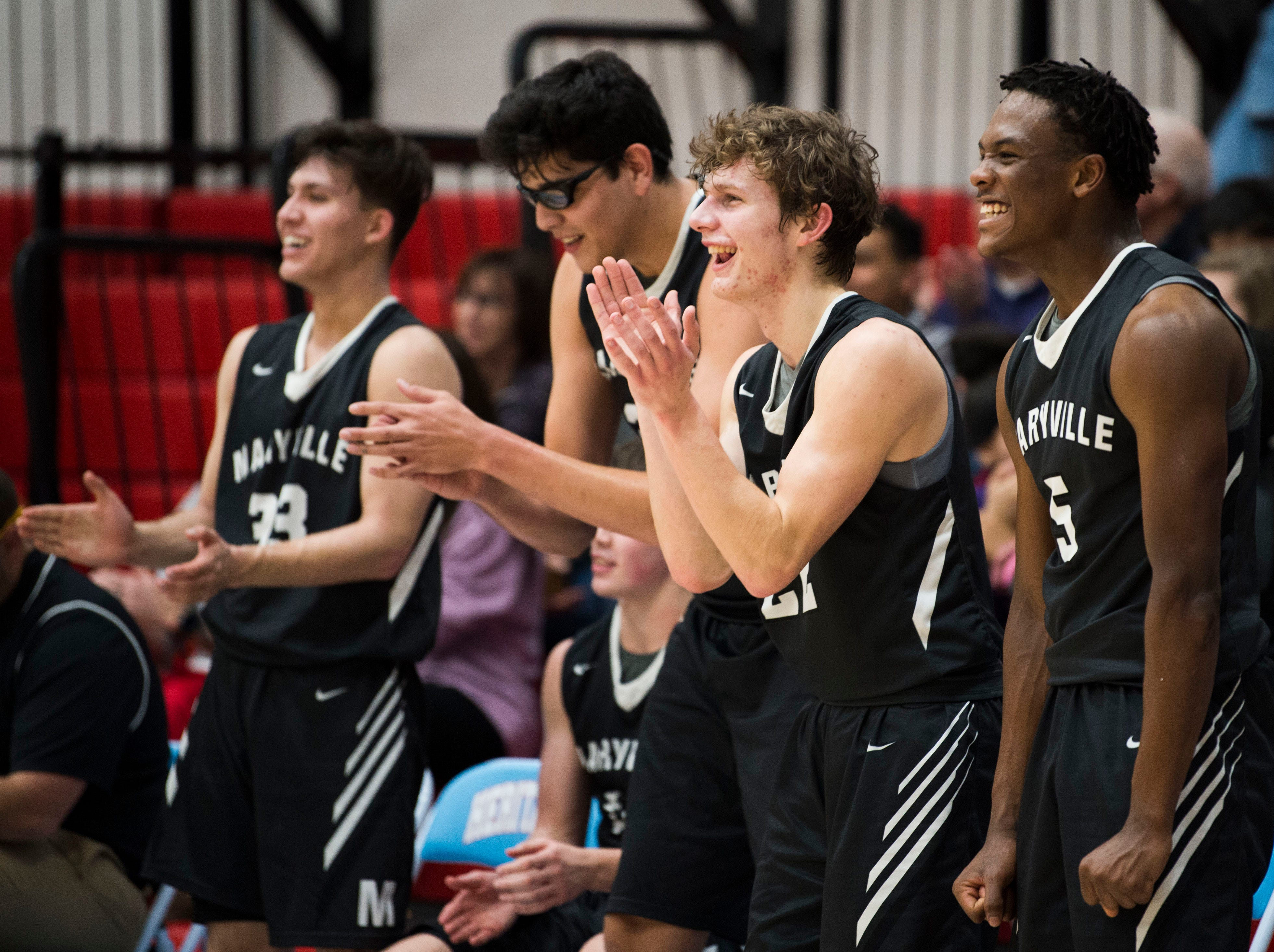 Maryville players celebrate a basket from the bench during a high school basketball game between Maryville and Heritage at Heritage Friday, Jan. 4, 2019. Both Maryville boys and girls teams beat Heritage.