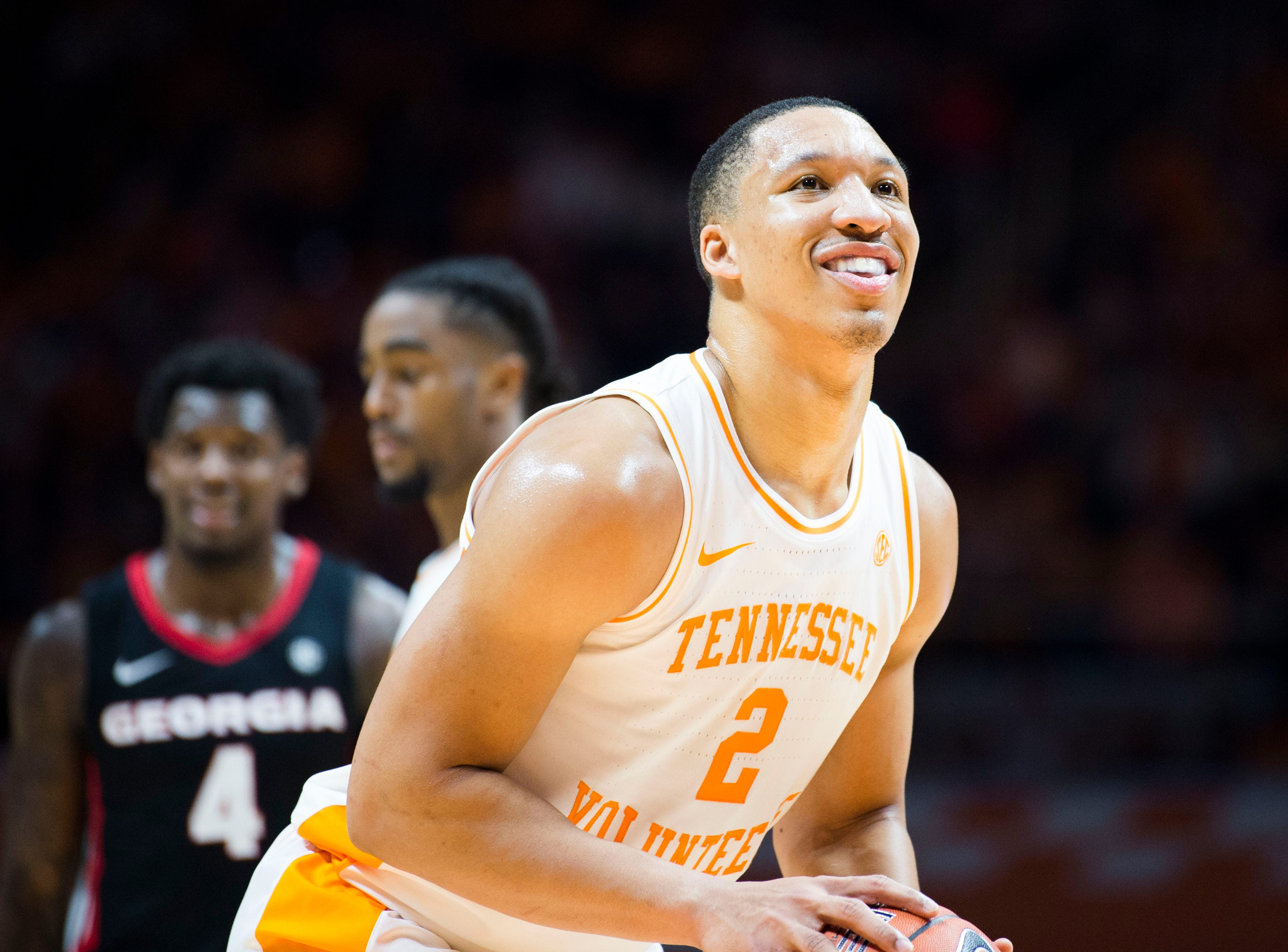 Tennessee's Grant Williams (2) smiles while taking a foul shot during a college basketball game between Tennessee and Georgia at Thompson-Boling Arena Saturday, Jan. 5, 2019.