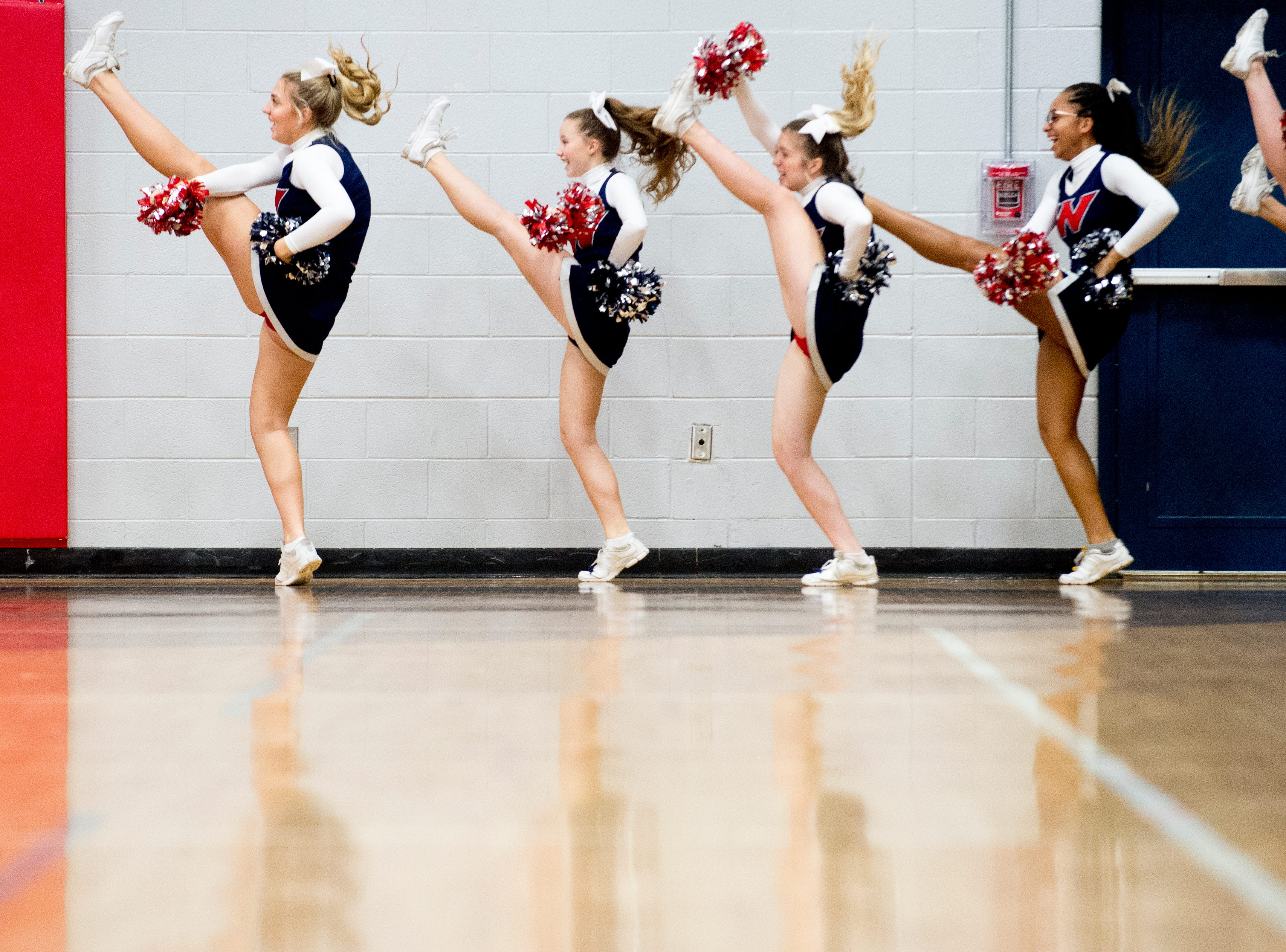 West High School cheerleaders cheer during a game between West and Webb at West High School in Knoxville, Tennessee on Friday, January 4, 2019.