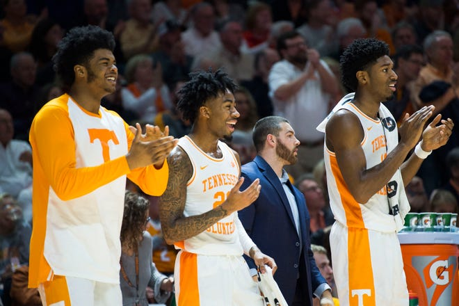 Tennessee players celebrate on the bench against Georgia on Saturday.