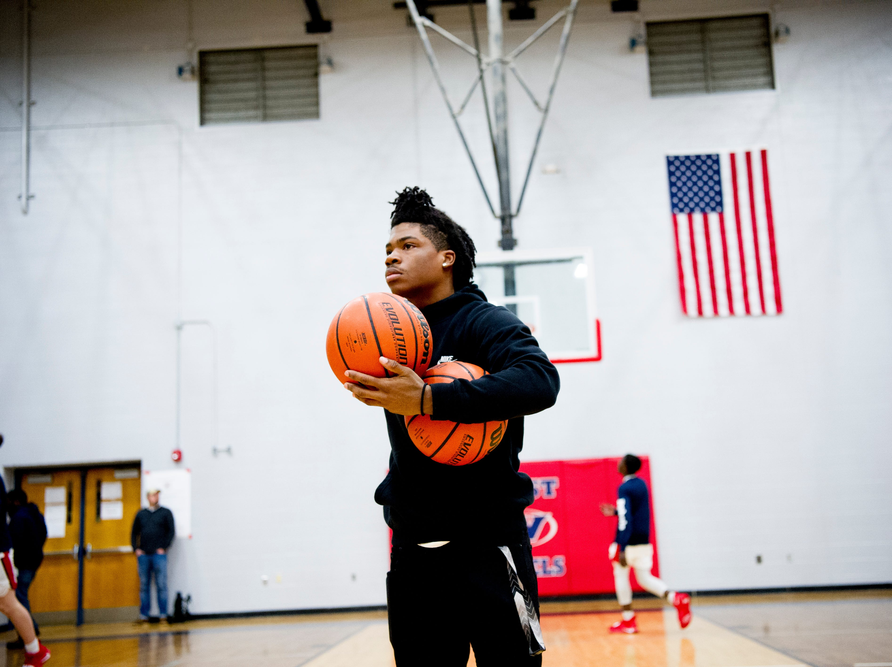 A West team member during team warm ups on the court during a game between West and Webb at West High School in Knoxville, Tennessee on Friday, January 4, 2019.