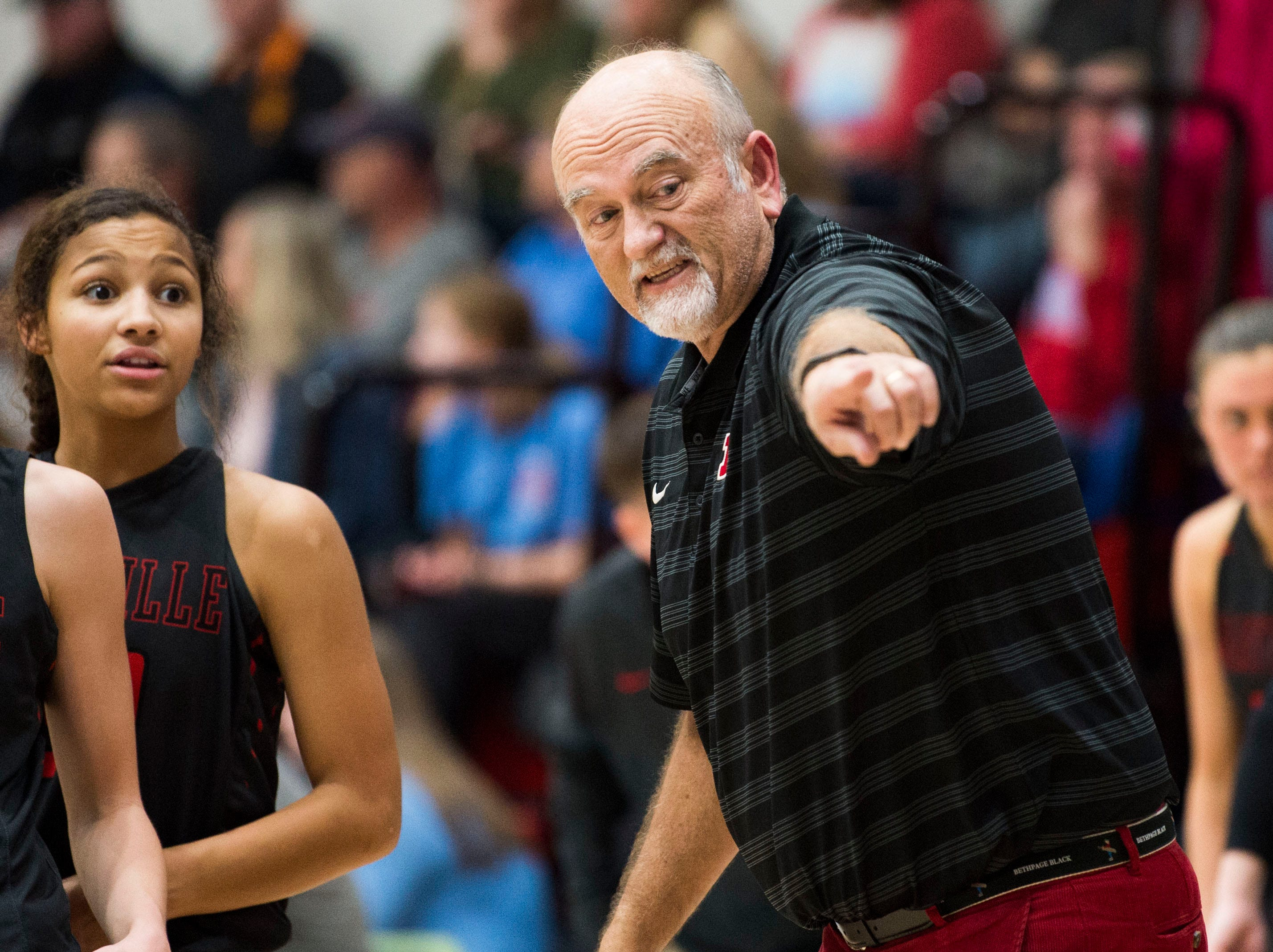 Maryville girls basketball coach Scott West points to the court during a high school basketball game between Maryville and Heritage at Heritage Friday, Jan. 4, 2019. Both Maryville boys and girls teams beat Heritage.
