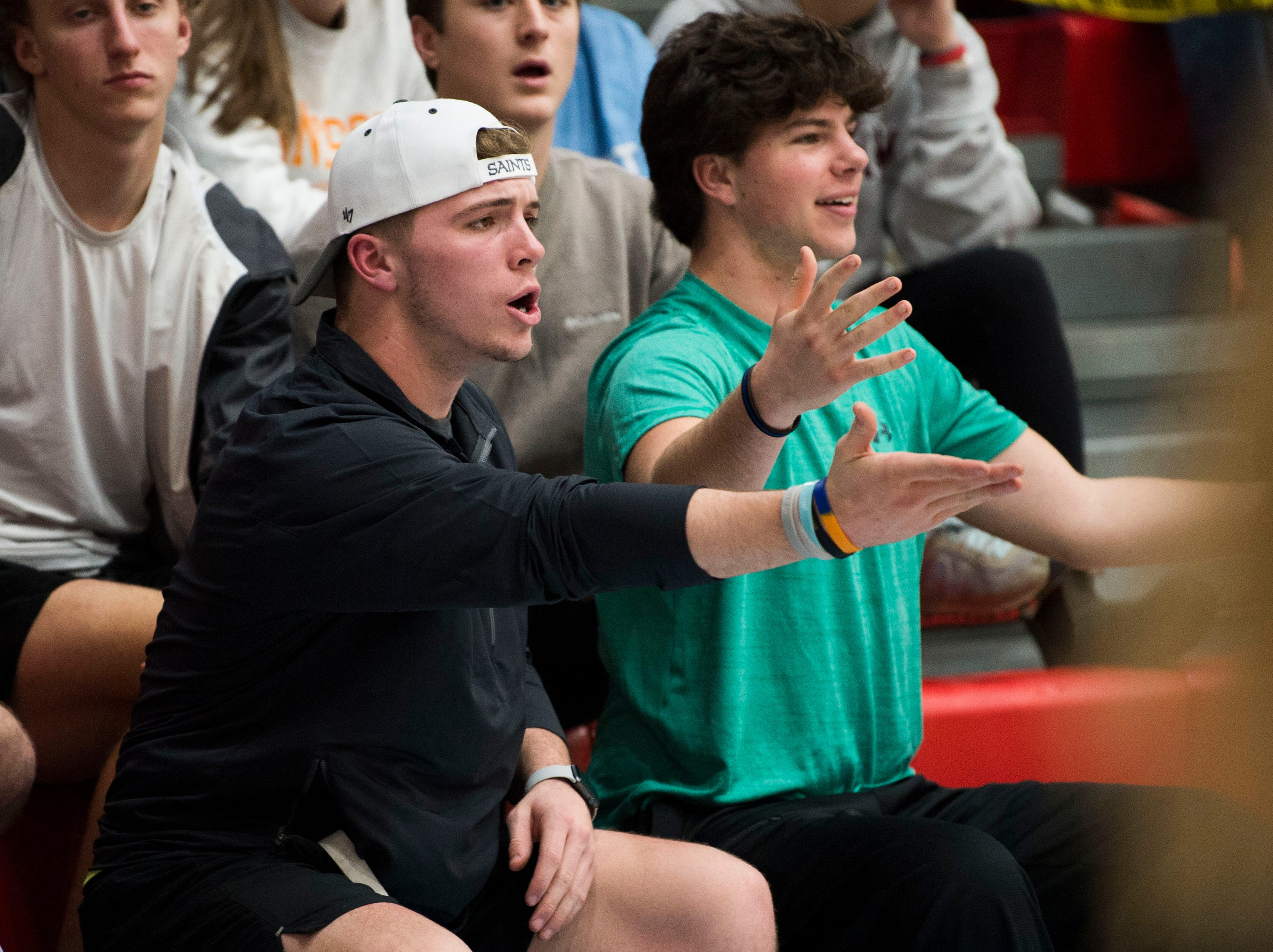 At left Brody Sloan of Maryville disagrees with a call during a high school basketball game between Maryville and Heritage at Heritage Friday, Jan. 4, 2019. Both Maryville boys and girls teams beat Heritage.