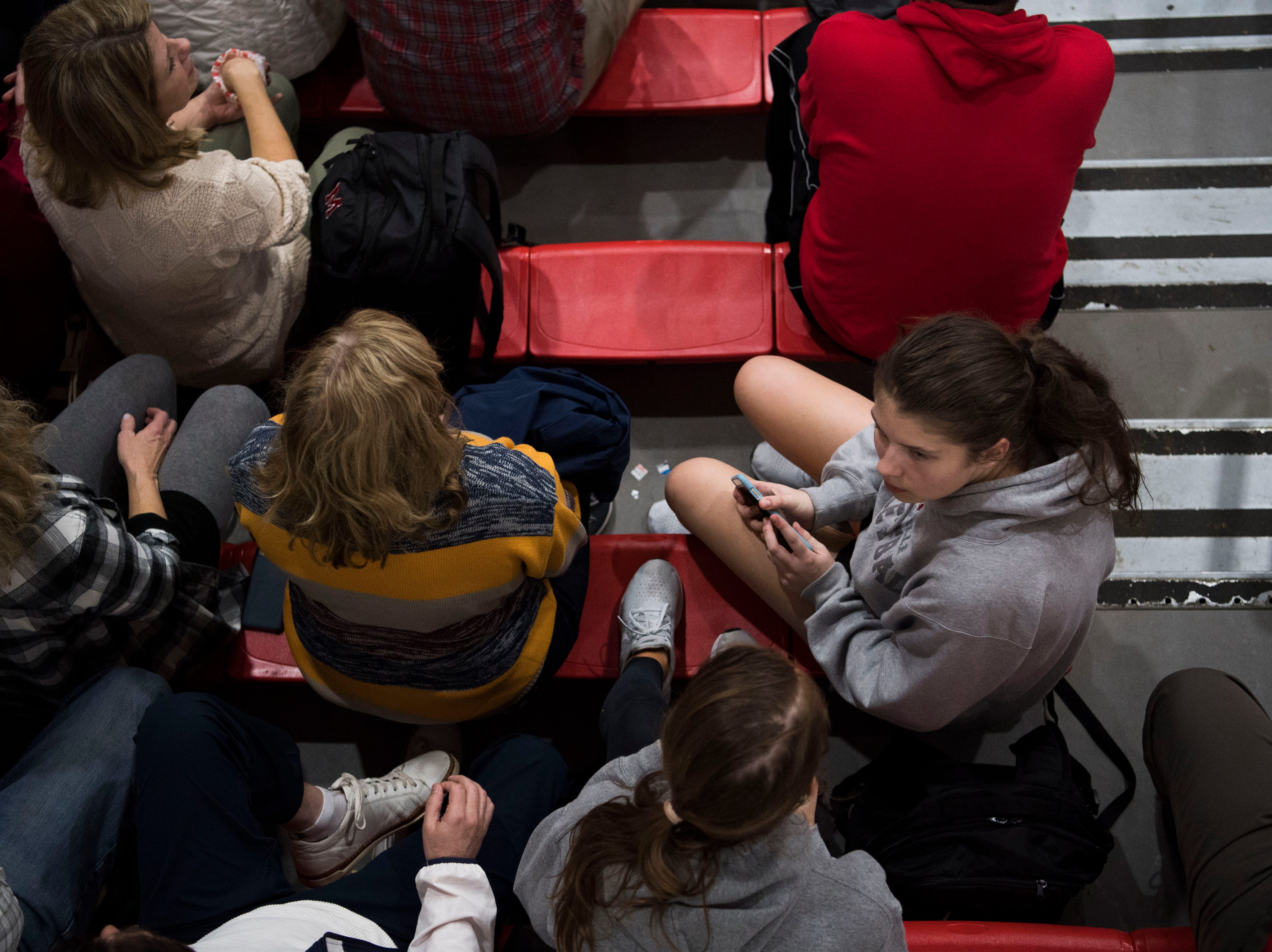 Fans sit in the stands before a high school basketball game between Maryville and Heritage at Heritage Friday, Jan. 4, 2019. Both Maryville boys and girls teams beat Heritage.