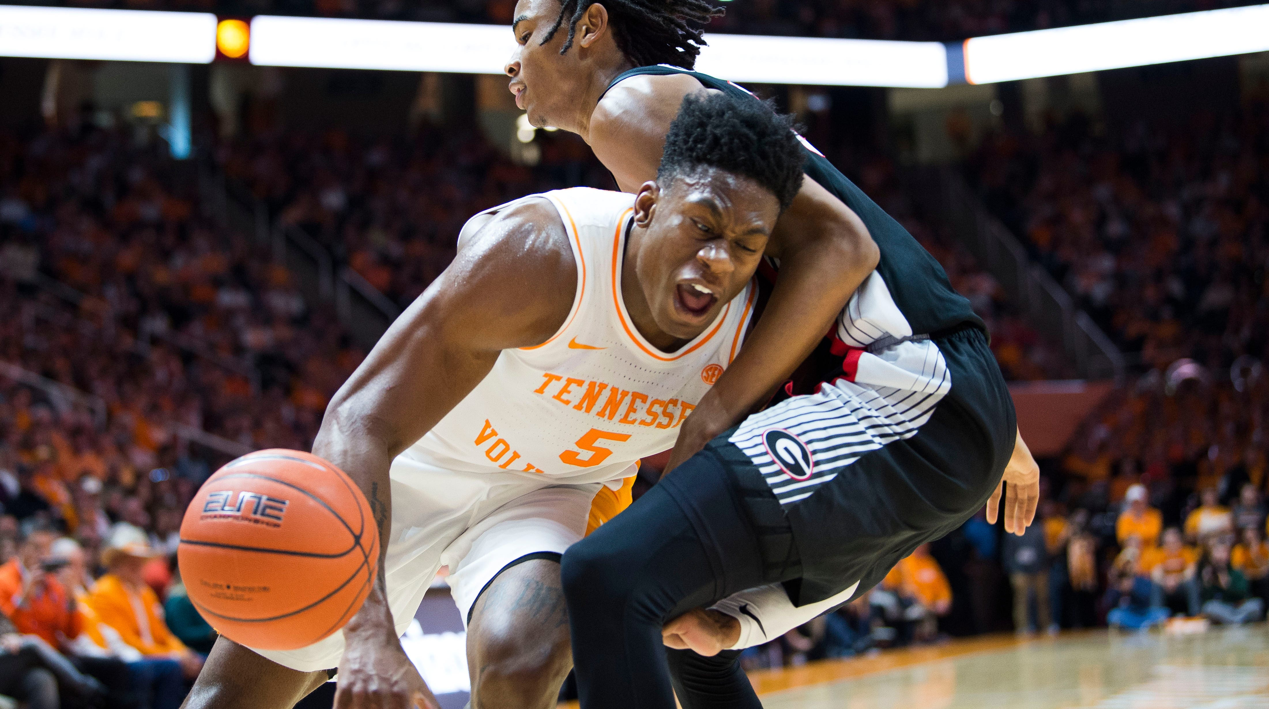 Tennessee's Admiral Schofield (5) is fouled by Georgia's Nicolas Clazton (33) during a college basketball game between Tennessee and Georgia at Thompson-Boling Arena Saturday, Jan. 5, 2019.