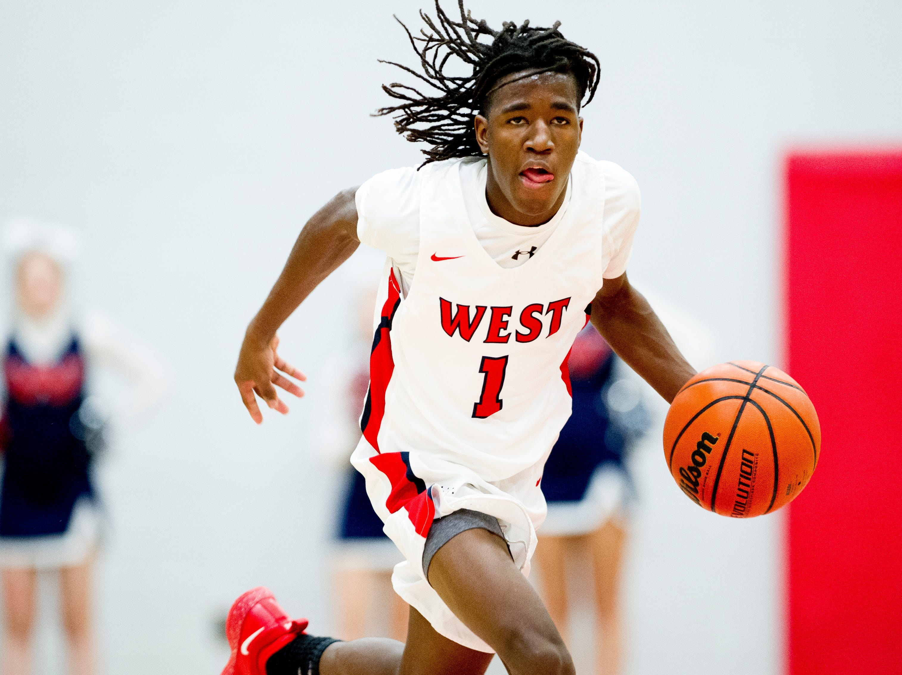 West's Michael Webb (1) dribbles the ball down the court during a game between West and Webb at West High School in Knoxville, Tennessee on Friday, January 4, 2019.