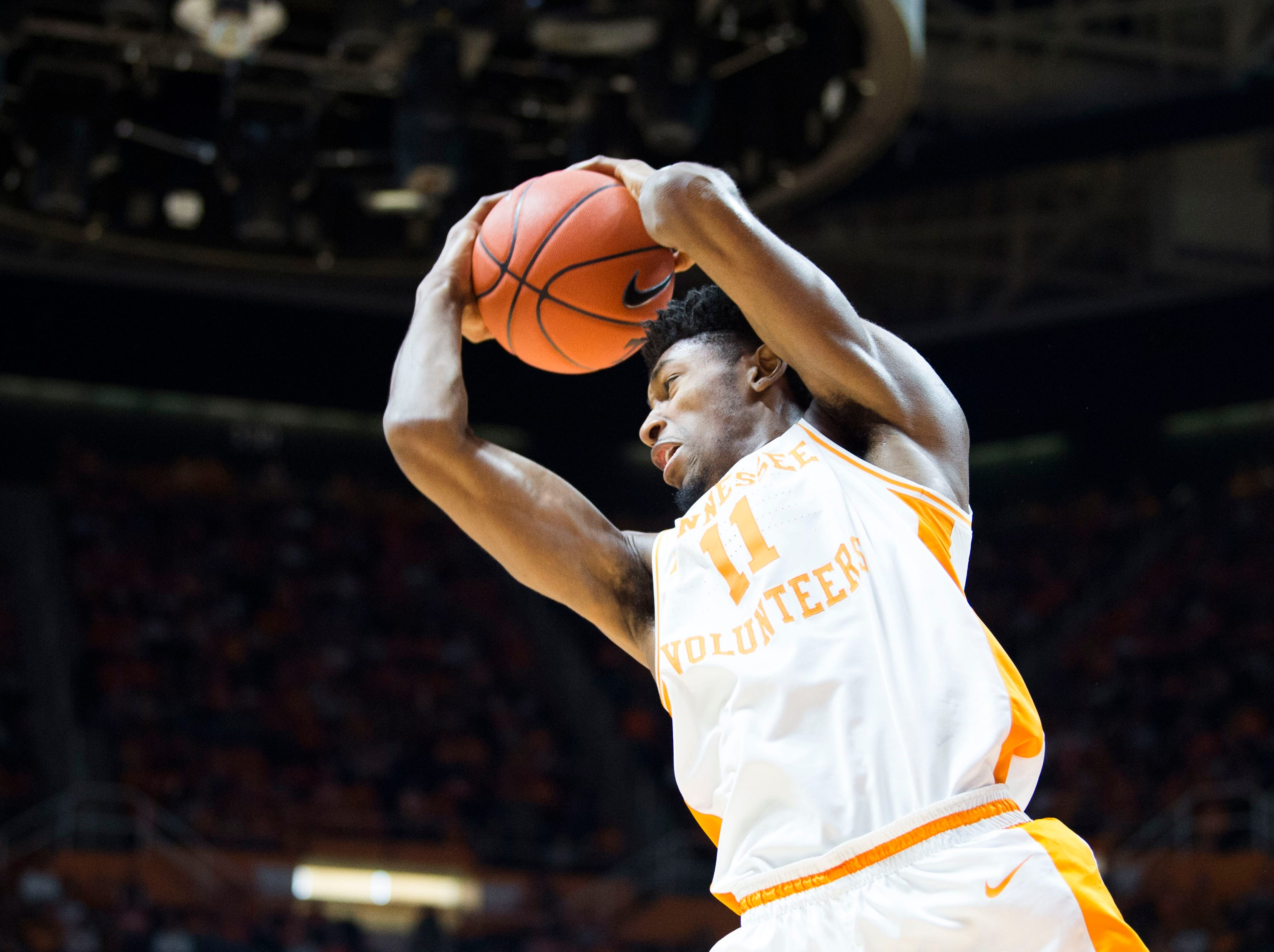 Tennessee's Kyle Alexander (11) grabs a rebound during a college basketball game between Tennessee and Georgia at Thompson-Boling Arena Saturday, Jan. 5, 2019.