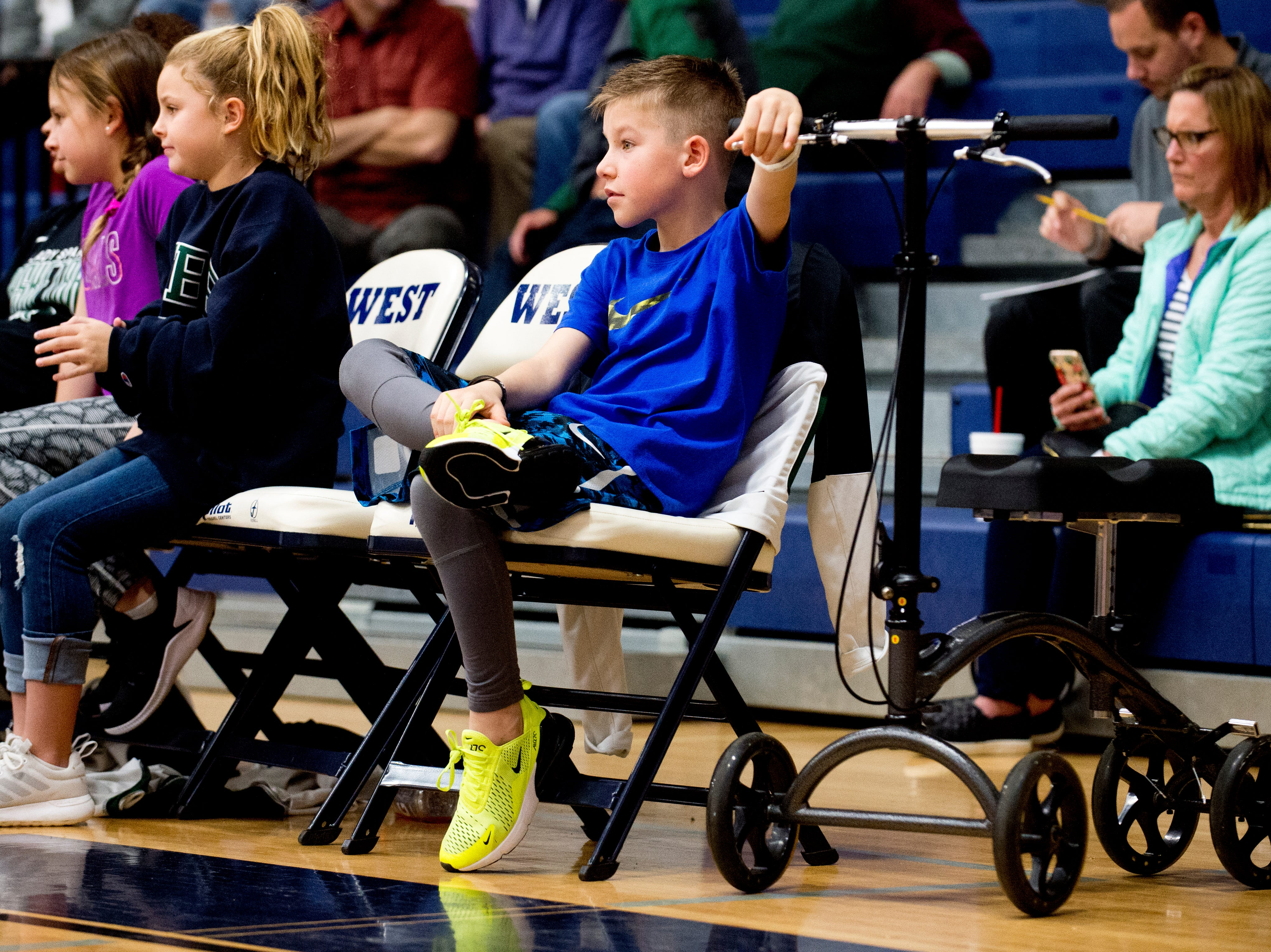 A boy watches the action from the bench during a game between West and Webb at West High School in Knoxville, Tennessee on Friday, January 4, 2019.