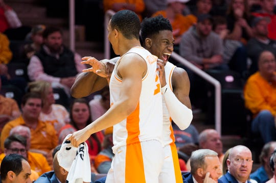 Tennessee's Admiral Schofield (5) celebrates with Tennessee's Grant Williams (2) during a college basketball game between Tennessee and Georgia at Thompson-Boling Arena Saturday, Jan. 5, 2019. Tennessee defeated Georgia 96-50.