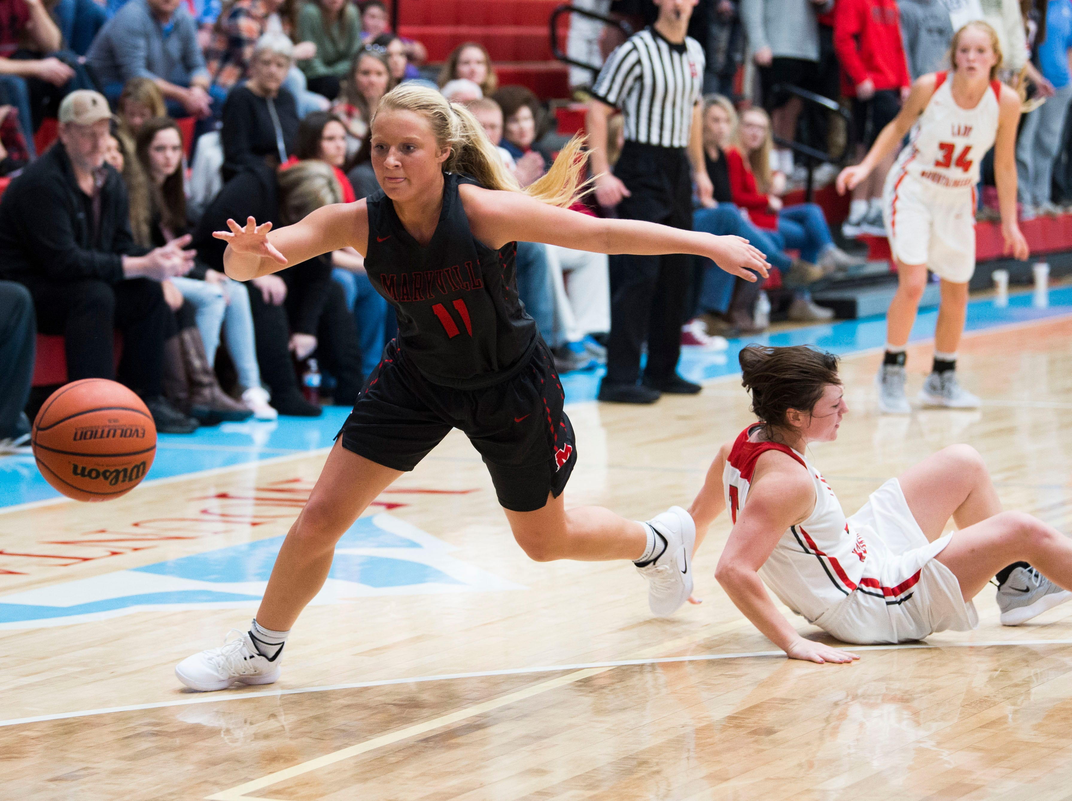 Maryville's Courtney Carruthers (11) gains possession of the ball during a high school basketball game between Maryville and Heritage at Heritage Friday, Jan. 4, 2019. Both Maryville boys and girls teams beat Heritage.