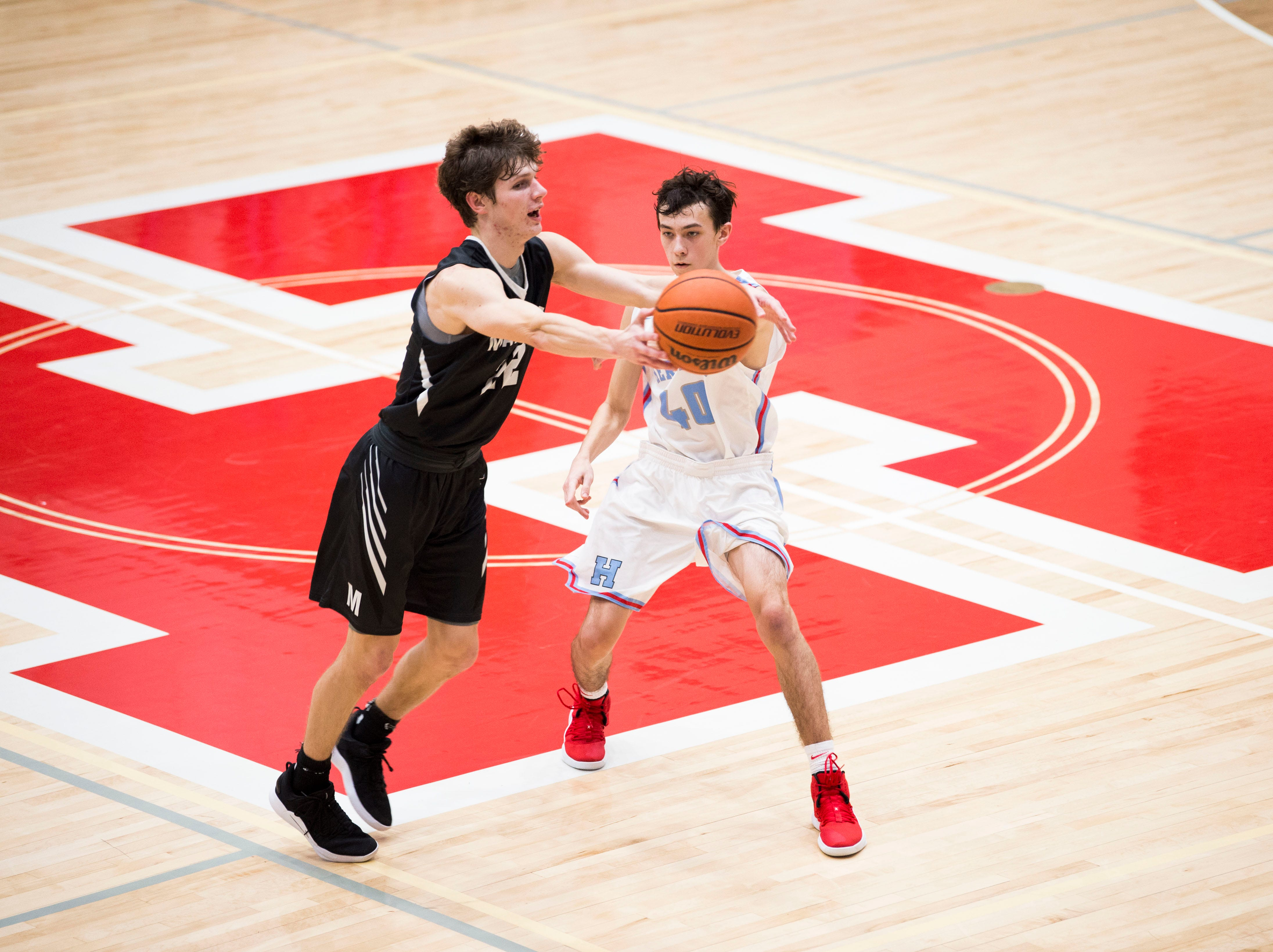 Maryville's Joe Anderson (22) defends Heritage's Brett Buckner (40)during a high school basketball game between Maryville and Heritage at Heritage Friday, Jan. 4, 2019. Both Maryville boys and girls teams beat Heritage.