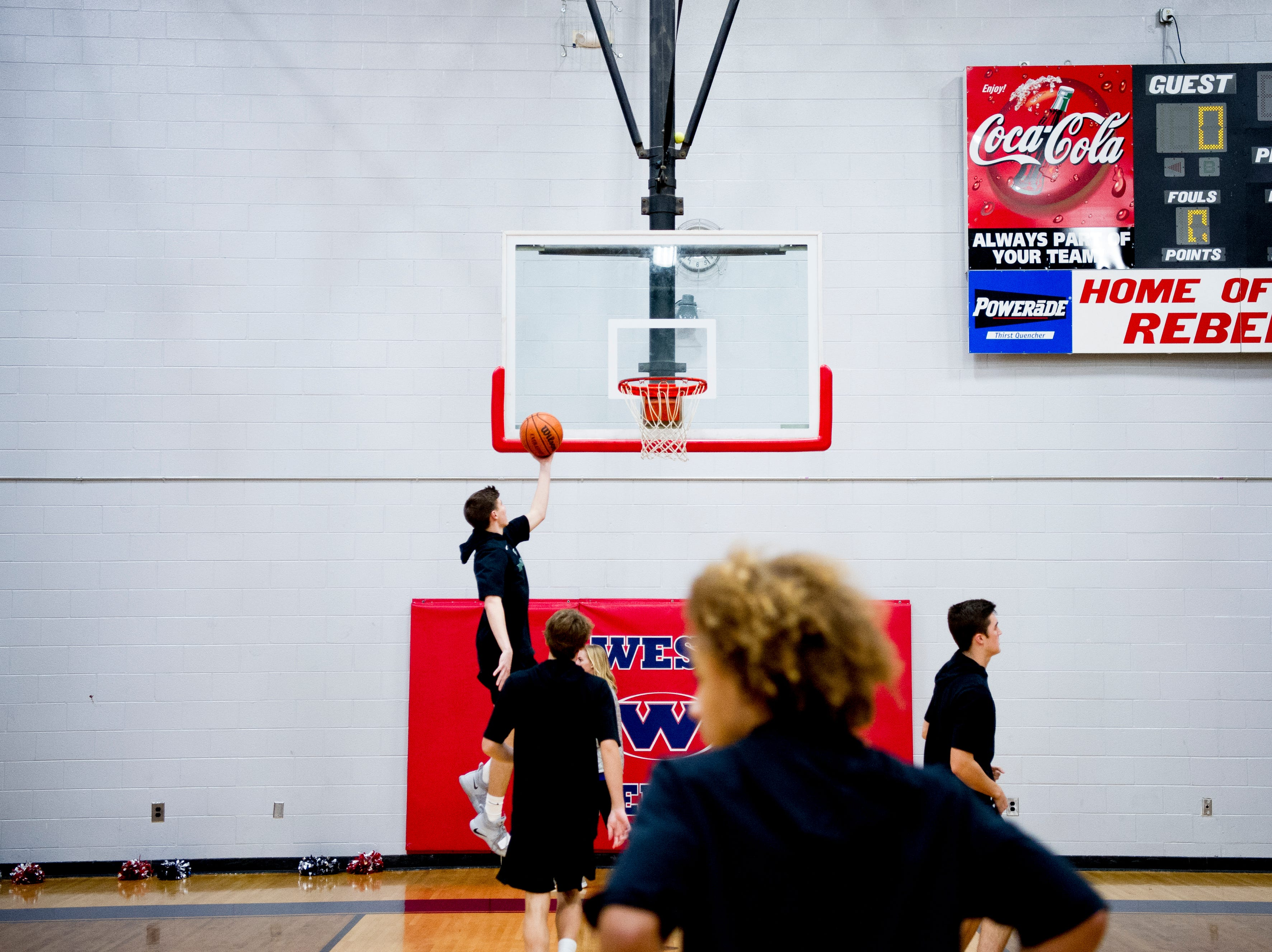 West players warm up on the court during a game between West and Webb at West High School in Knoxville, Tennessee on Friday, January 4, 2019.