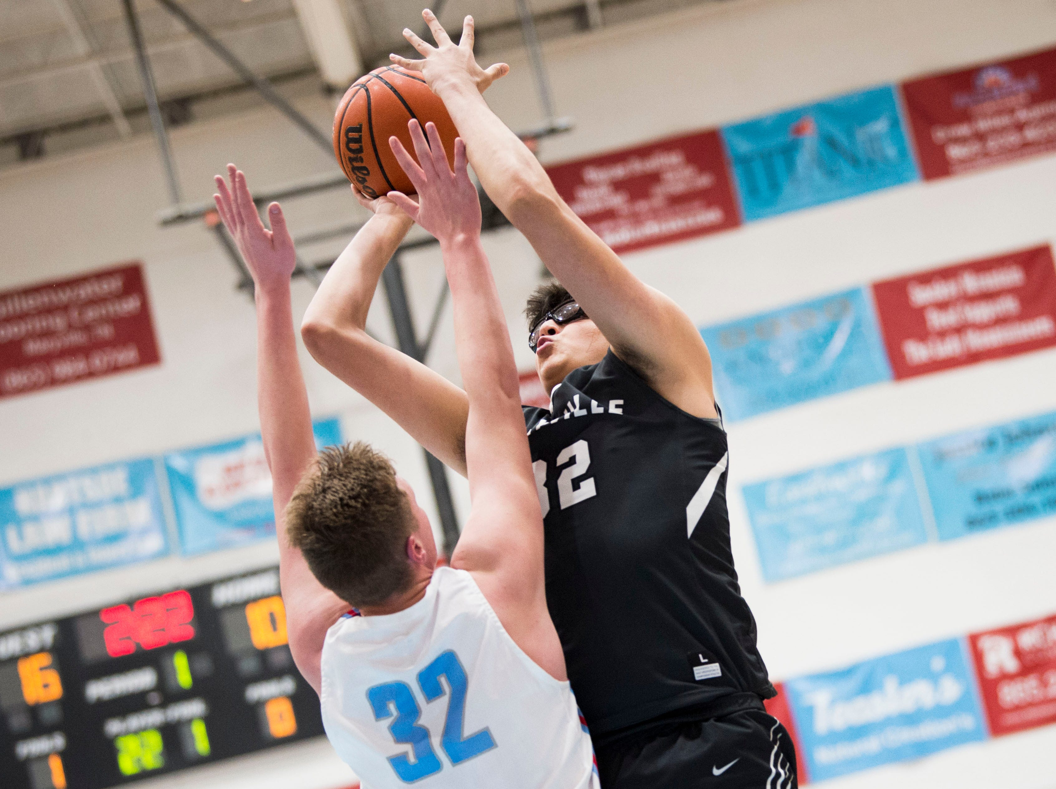 Maryville's Elmaden Gara (32) takes a shot during a high school basketball game between Maryville and Heritage at Heritage Friday, Jan. 4, 2019. Both Maryville boys and girls teams beat Heritage.