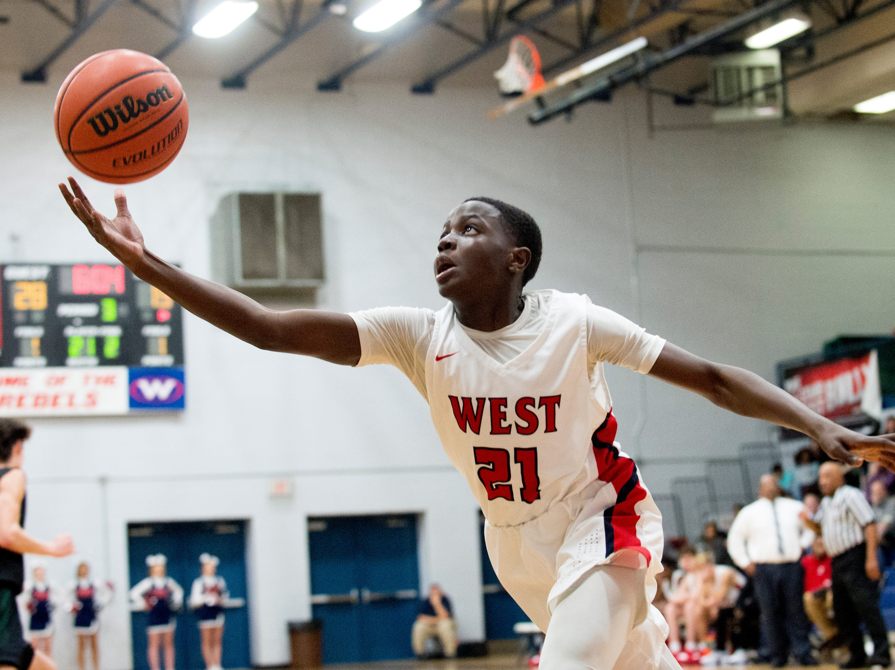 West's Michael Davis (21) reaches for the ball during a game between West and Webb at West High School in Knoxville, Tennessee on Friday, January 4, 2019.