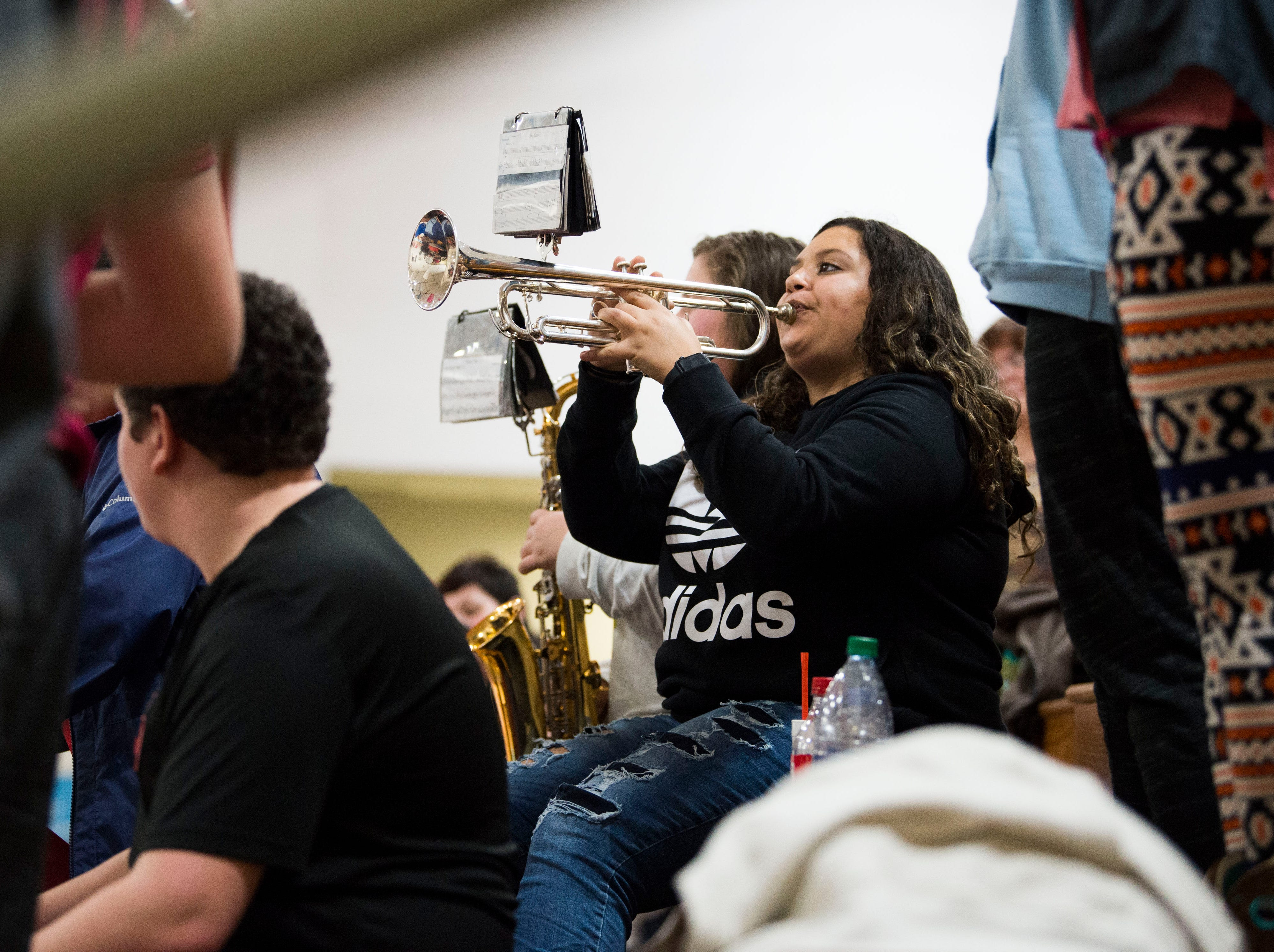 A member of the Heritage band plays during a high school basketball game between Maryville and Heritage at Heritage Friday, Jan. 4, 2019. Both Maryville boys and girls teams beat Heritage.