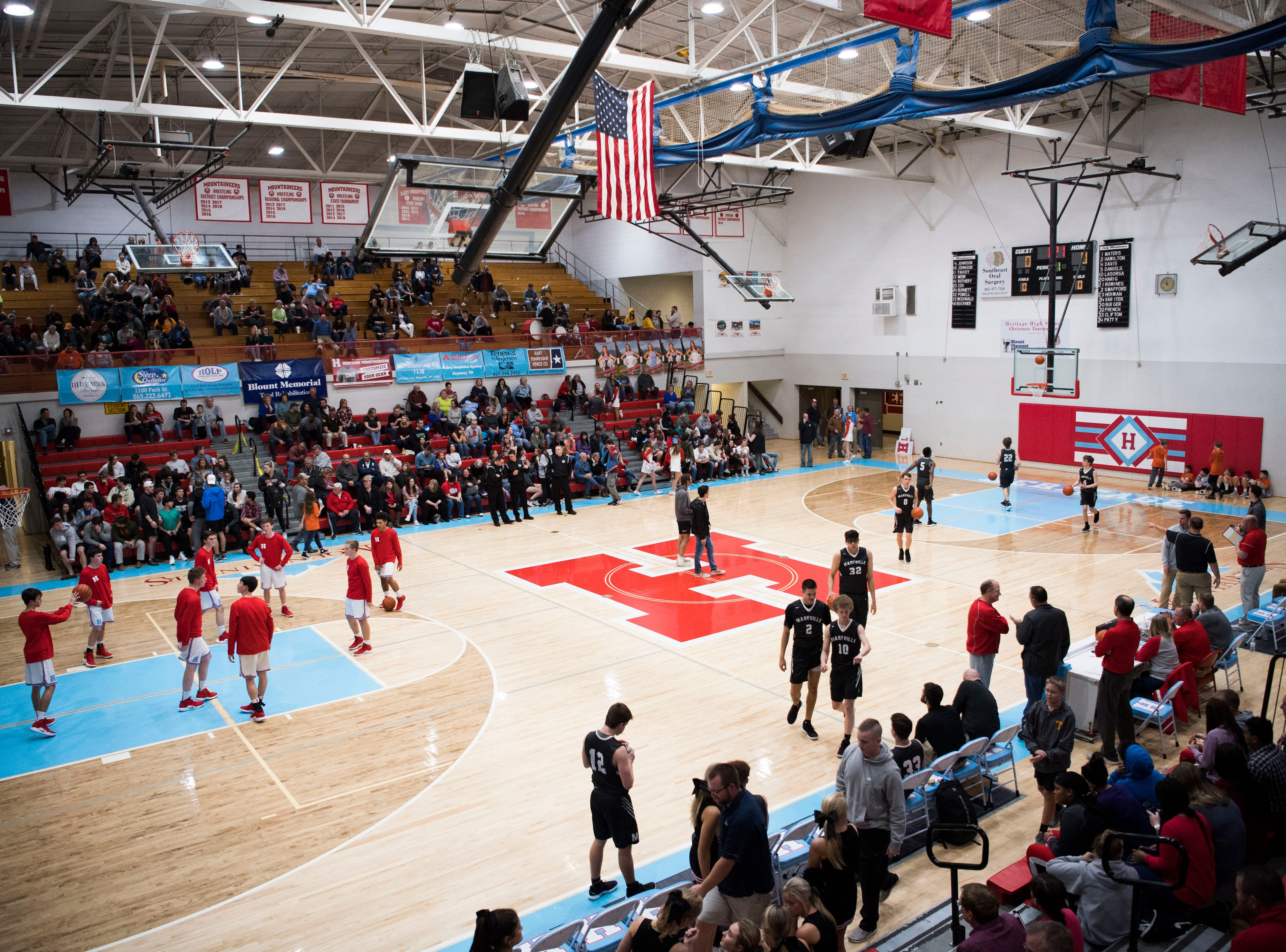 Players warm up on the court before a high school basketball game between Maryville and Heritage at Heritage Friday, Jan. 4, 2019. Both Maryville boys and girls teams beat Heritage.