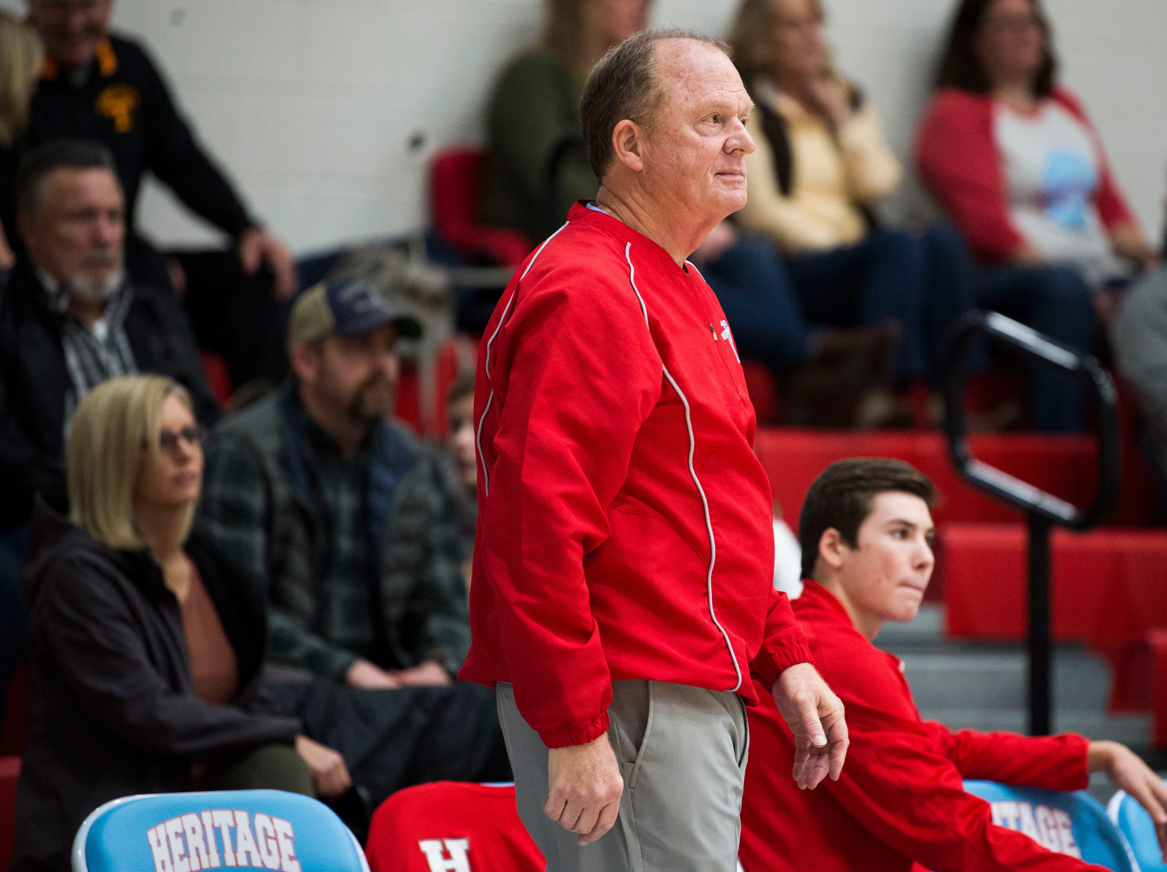 Heritage boys basketball coach Dennis Godfrey looks towards the court during a high school basketball game between Maryville and Heritage at Heritage Friday, Jan. 4, 2019. Both Maryville boys and girls teams beat Heritage.