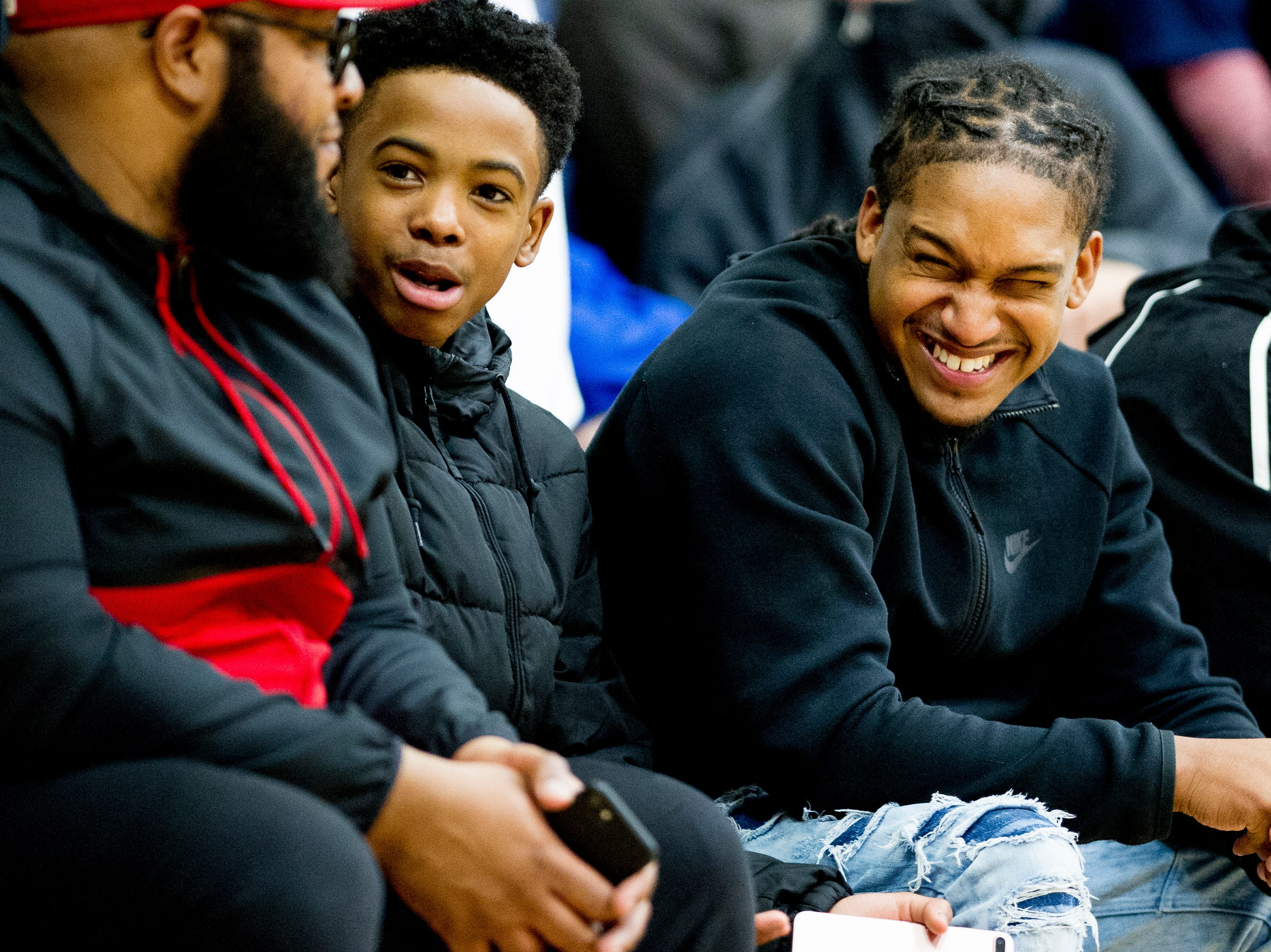 Fans share a laugh in the bleachers during a game between West and Webb at West High School in Knoxville, Tennessee on Friday, January 4, 2019.