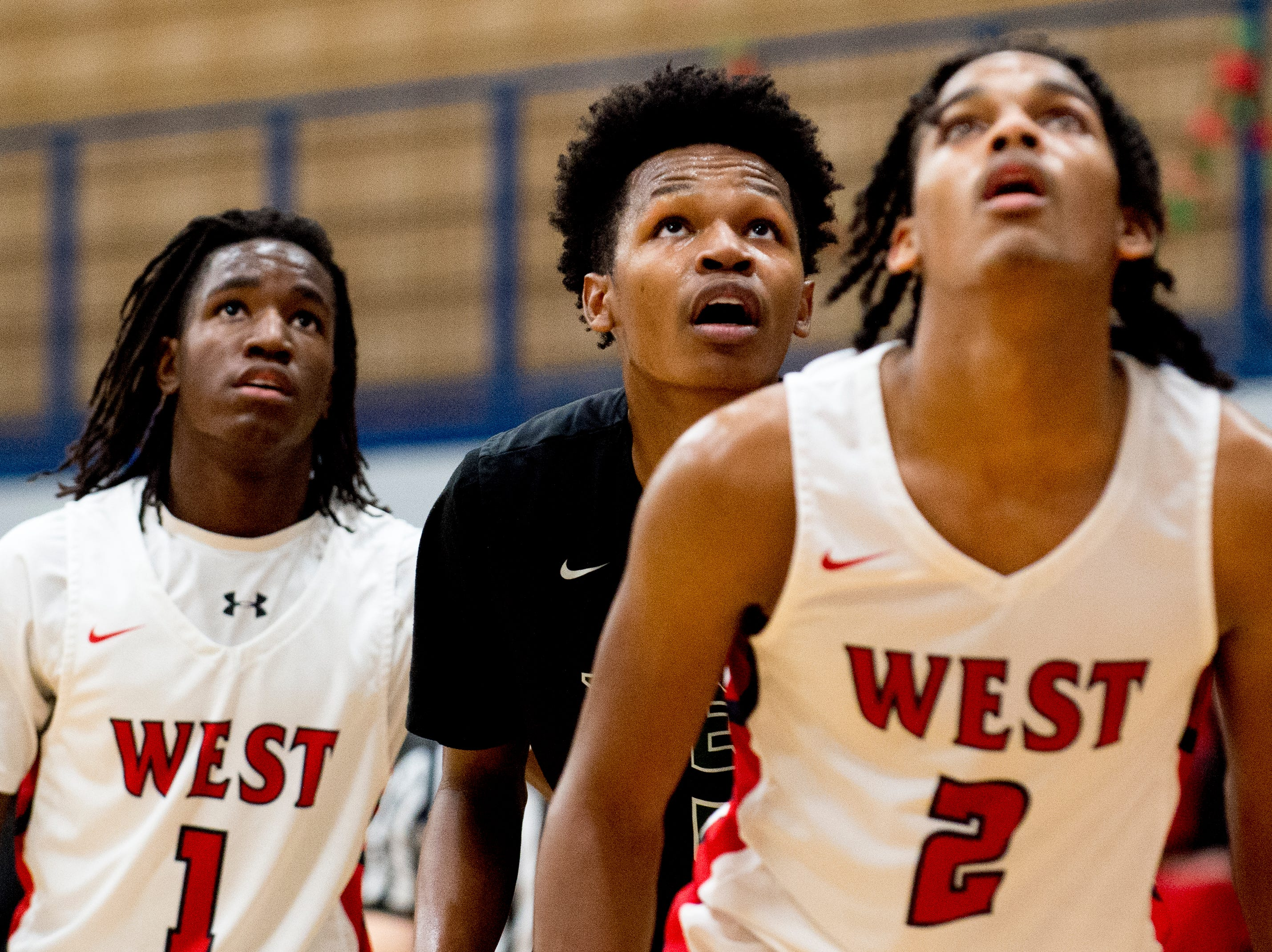 Webb's Tariq Daughter (5) eyes the ball with West's Michael Webb (1) and Cedarius Bost (2) during a game between West and Webb at West High School in Knoxville, Tennessee on Friday, January 4, 2019.