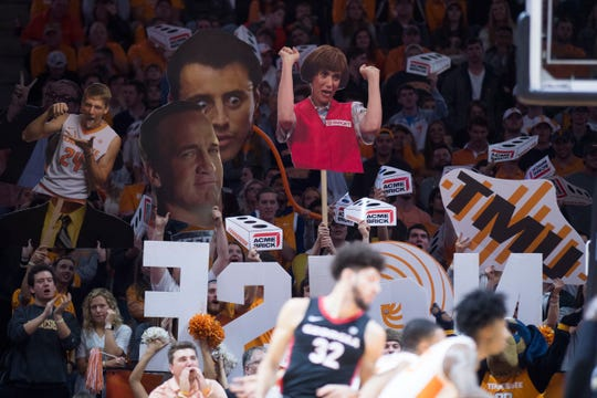 Fans hold up signs during a college basketball game between Tennessee and Georgia at Thompson-Boling Arena Saturday, Jan. 5, 2019.