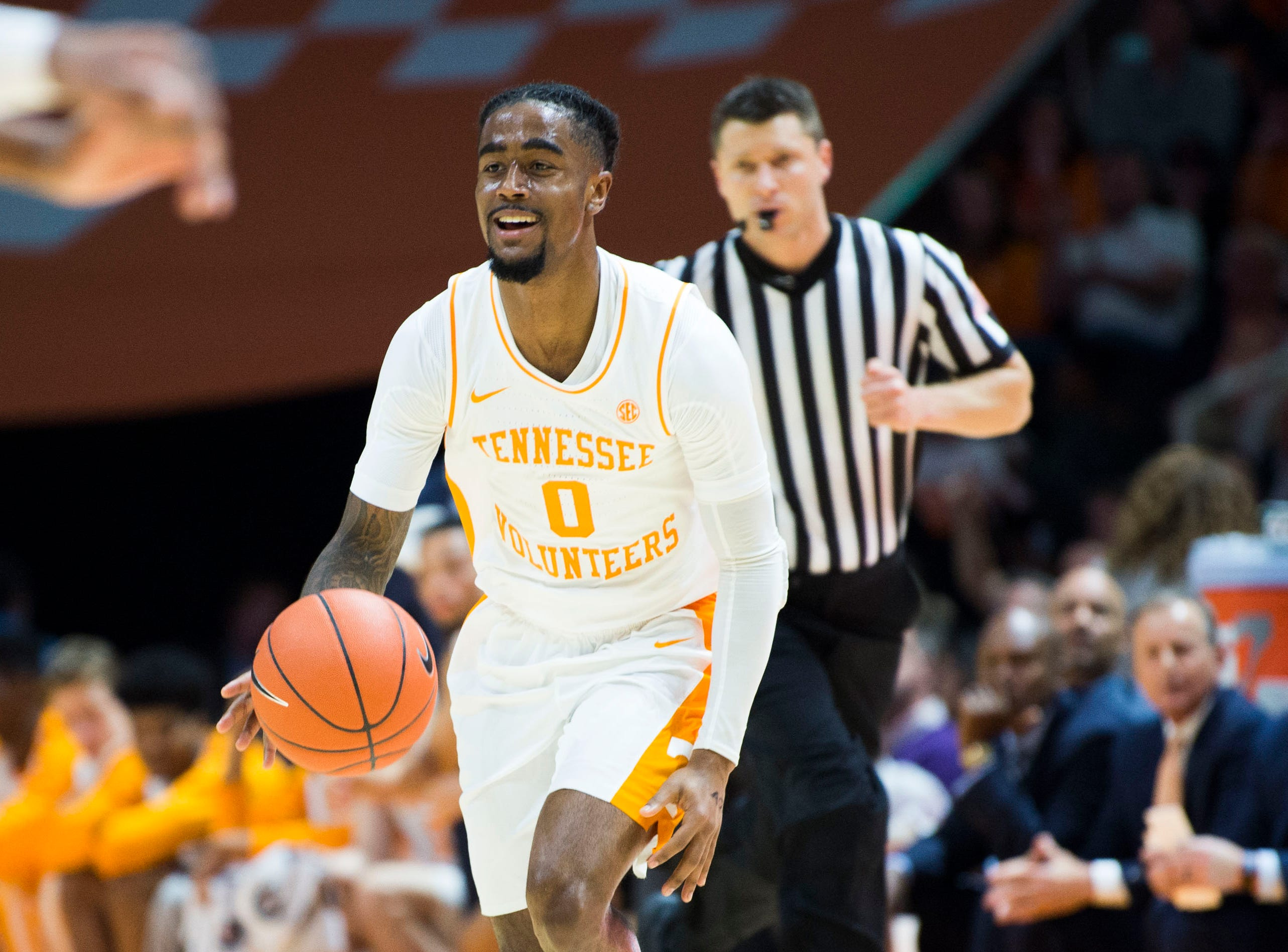 Tennessee's Jordan Bone (0) smiles while dribbling the ball during a college basketball game between Tennessee and Georgia at Thompson-Boling Arena Saturday, Jan. 5, 2019.