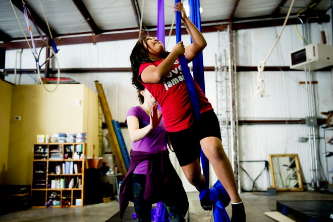Paola Rojas-Meza, 9, tries out the fabric with instructor Katlyn Gagnier during an open house event at Dragonfly Circus School in Knoxville, Tennessee on Saturday, January 5, 2019. The open house featured free lessons of aerial circus arts for children and adults alike.