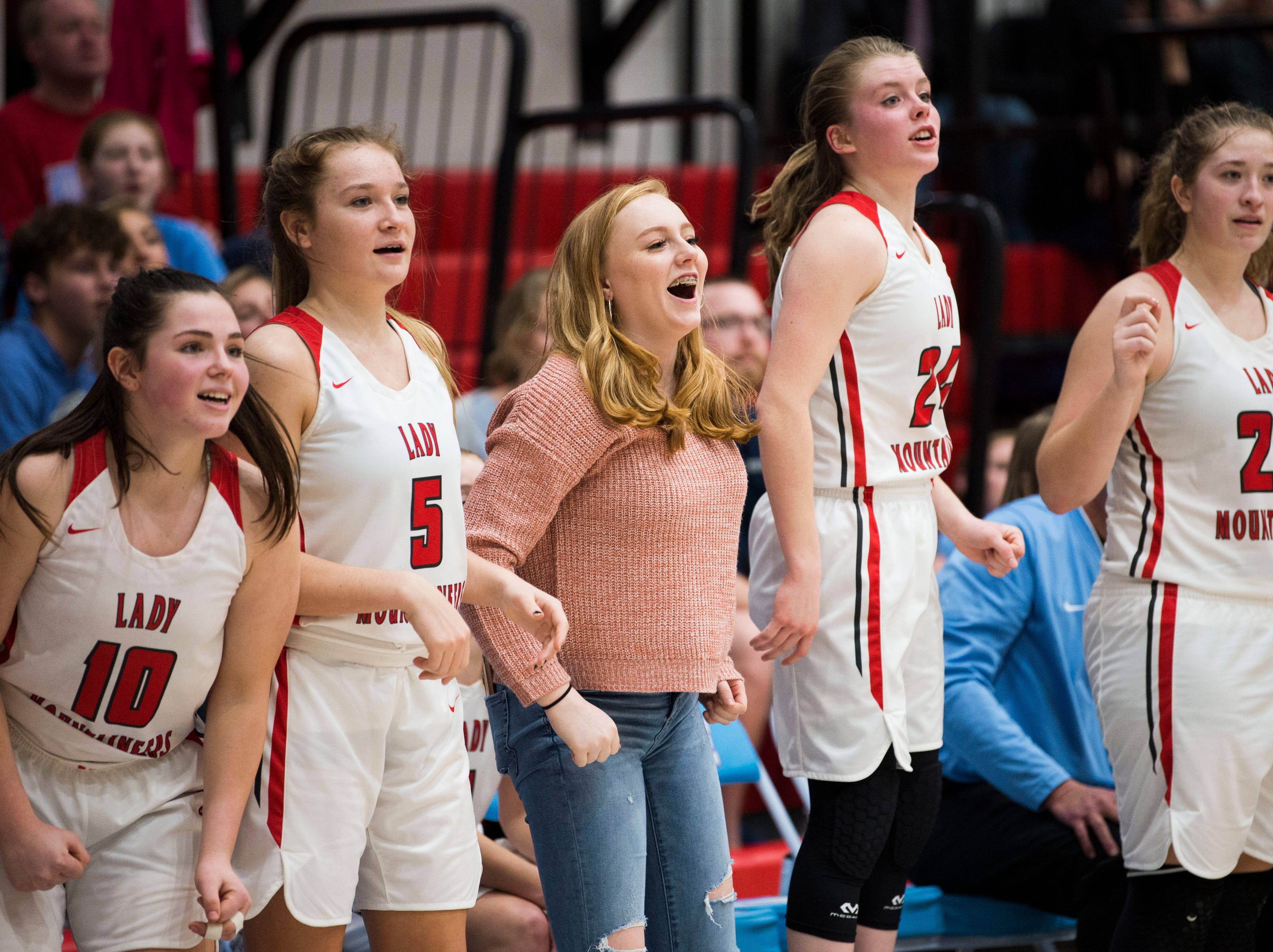 Heritage players cheer from the bench during a high school basketball game between Maryville and Heritage at Heritage Friday, Jan. 4, 2019. Both Maryville boys and girls teams beat Heritage.