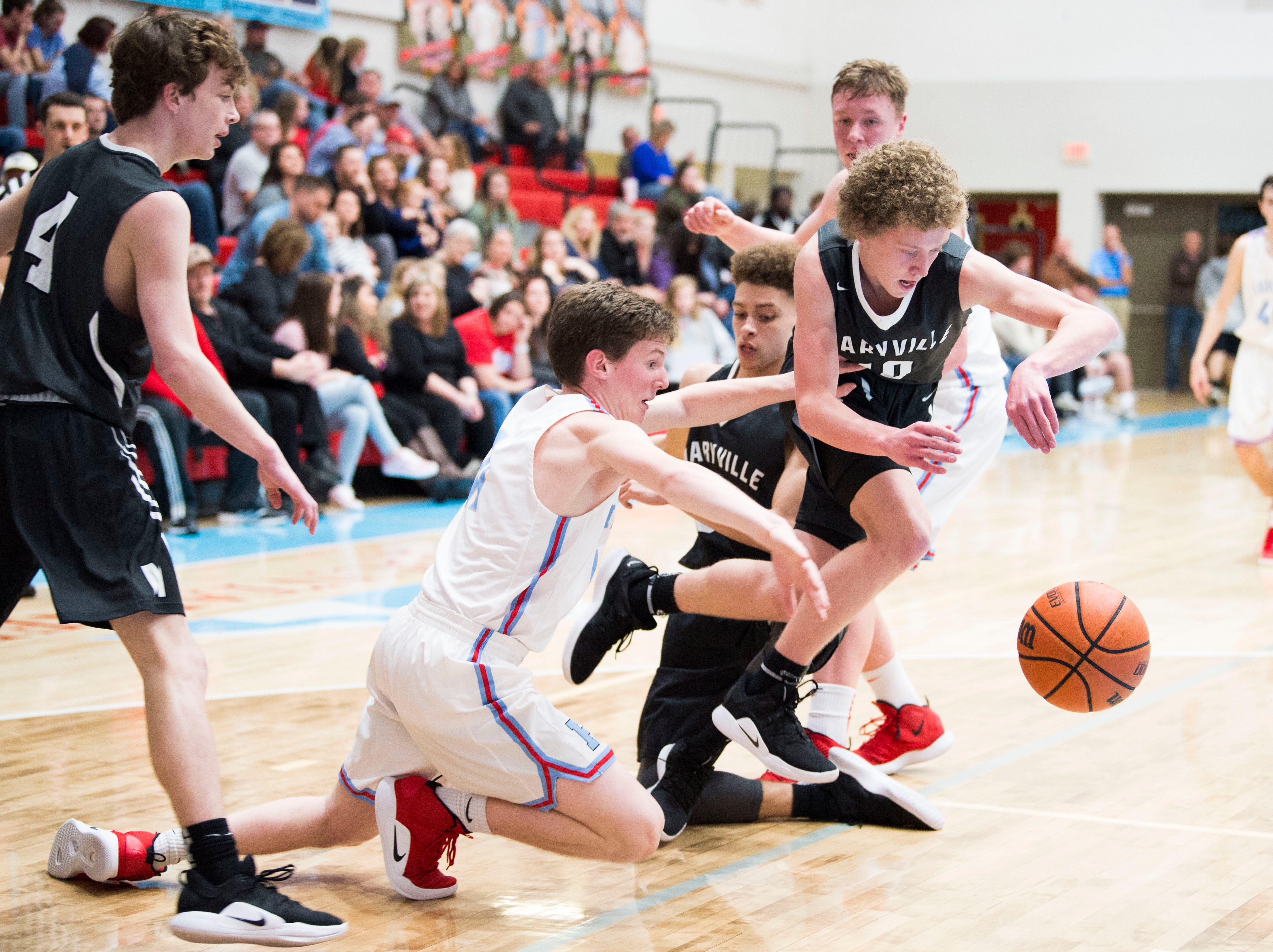 Maryville's Charlie Rice (10) gains possession of the ball during a high school basketball game between Maryville and Heritage at Heritage Friday, Jan. 4, 2019. Both Maryville boys and girls teams beat Heritage.