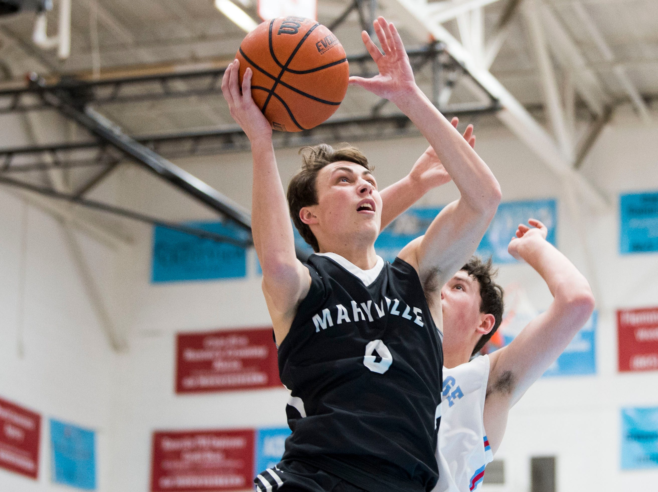 Maryville's Drew Crowder (0) takes a shot during a high school basketball game between Maryville and Heritage at Heritage Friday, Jan. 4, 2019. Both Maryville boys and girls teams beat Heritage.