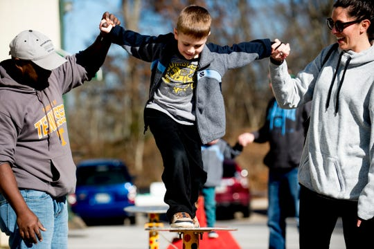 Kennedy Mayer, 4, of Knoxville, tries out the balance beam during an open house event at Dragonfly Circus School in Knoxville, Tennessee on Saturday, January 5, 2019. The open house featured free lessons of aerial circus arts for children and adults alike.