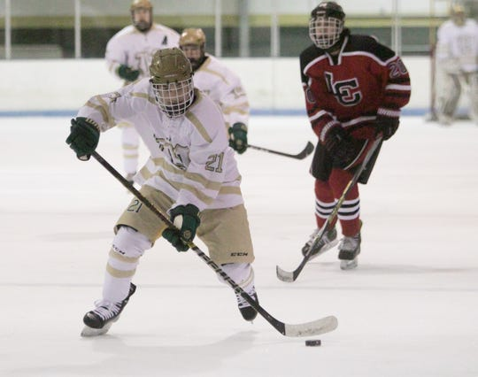 Howell's Graham Hassan (21) scored three goals and one assist in a 6-3 victory over Livonia Churchill on Friday, Jan. 4, 2019 at Grand Oaks Ice Arena.