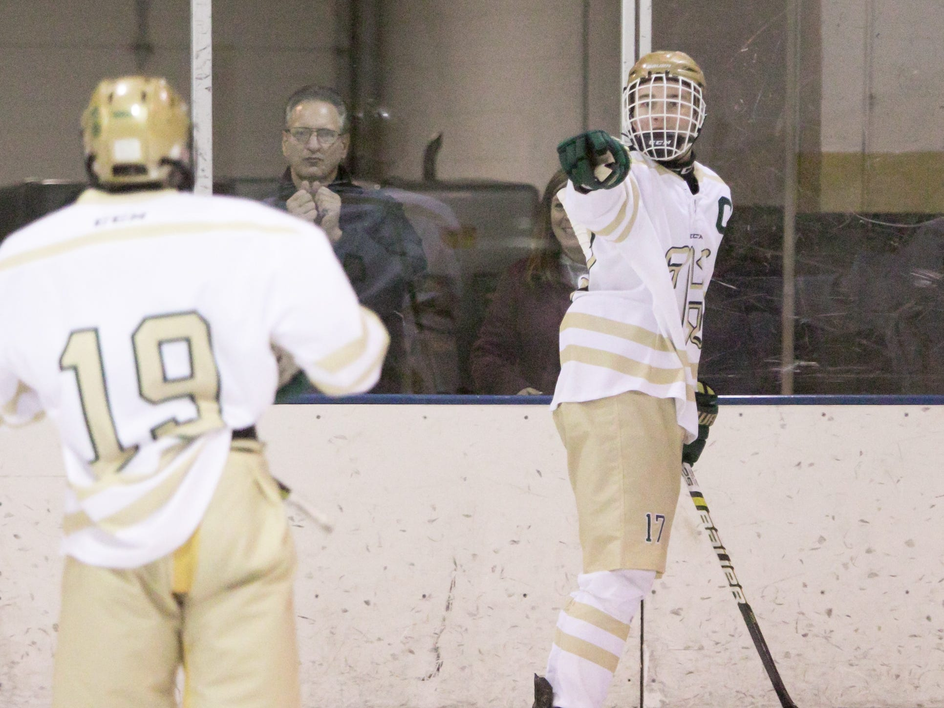 After scoring Howell's third goal, Josh Farr points to teammate Cam Nitschman in a 6-3 victory over Livonia Churchill on Friday, Jan. 4, 2019 at Grand Oaks Ice Arena.
