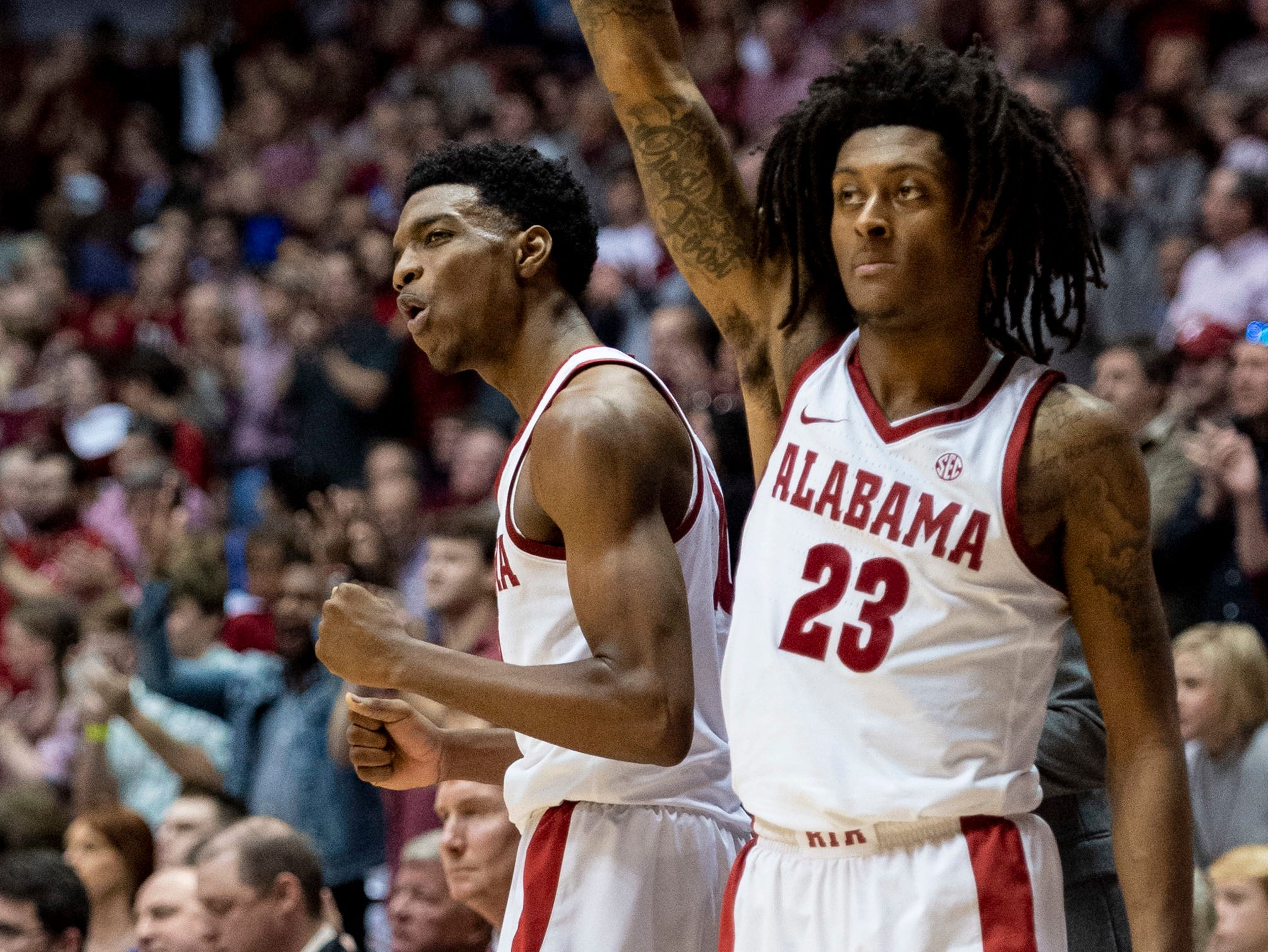 Alabama guards Herbert Jones (10) and John Petty (23) celebrate a three-pointer during the second half of an NCAA college basketball game against Kentucky, Saturday, Jan. 5, 2019, in Tuscaloosa, Ala.