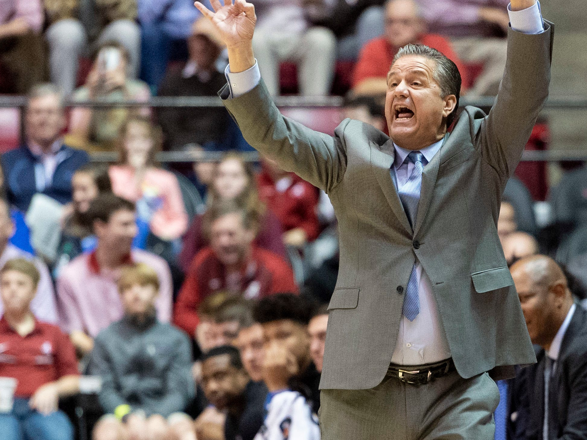 Kentucky head coach John Calipari signals against Alabama during the first half of an NCAA college basketball game, Saturday, Jan. 5, 2019, in Tuscaloosa, Ala.