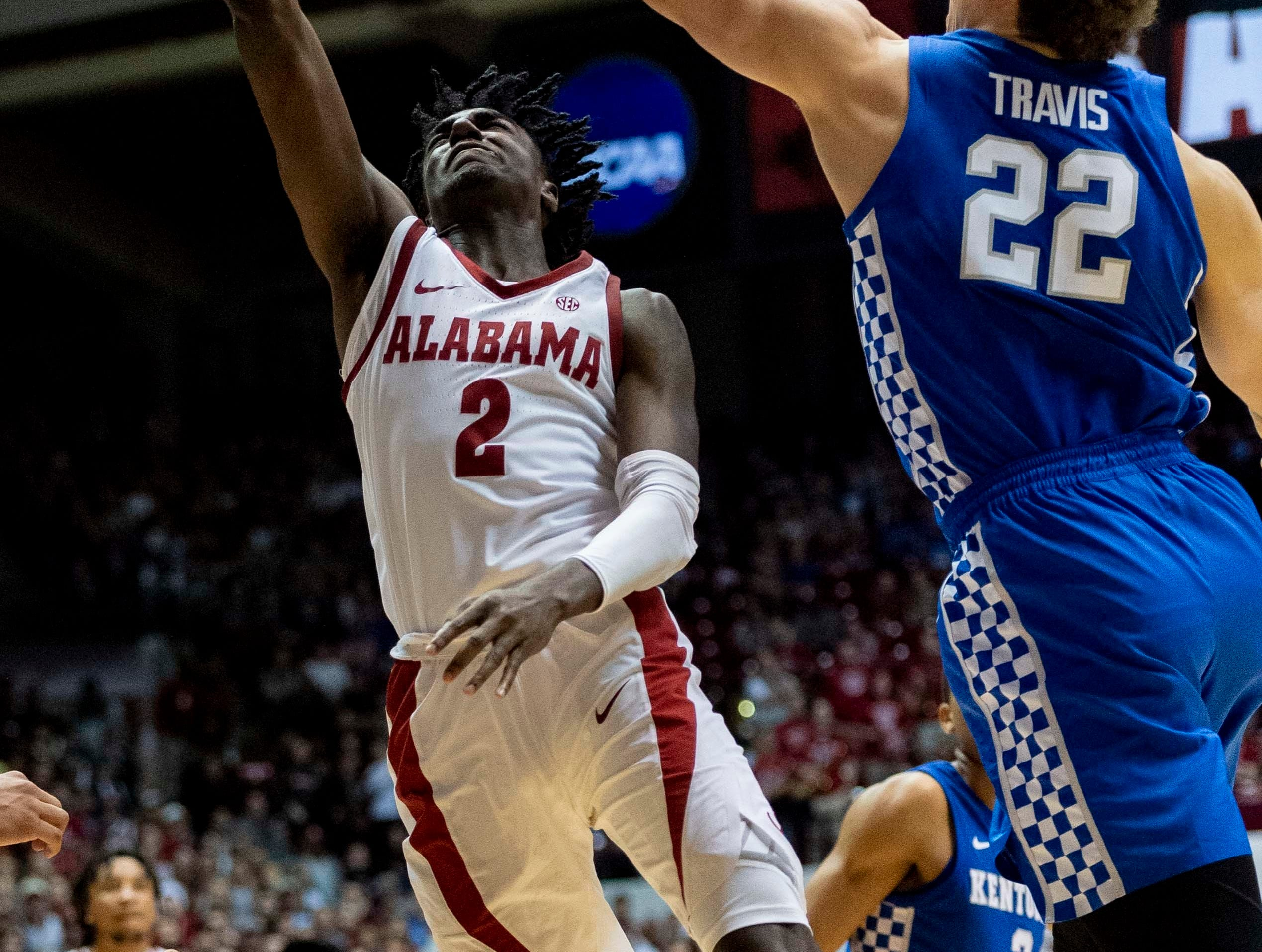 Alabama guard Kira Lewis Jr. (2) shoots past Kentucky forward Reid Travis (22) during the second half of an NCAA college basketball game, Saturday, Jan. 5, 2019, in Tuscaloosa, Ala.